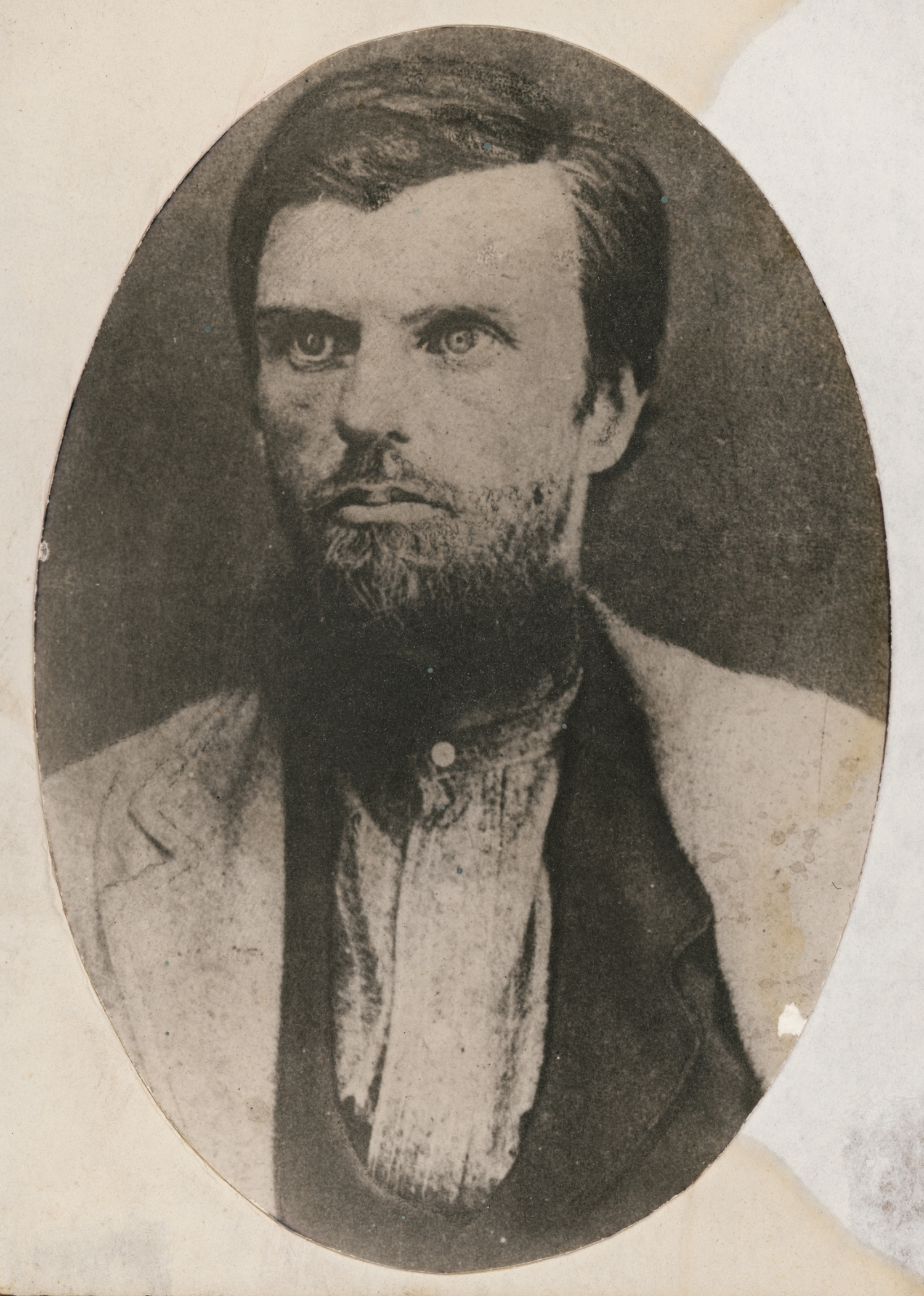 Portriat of man with sparse but long beard.