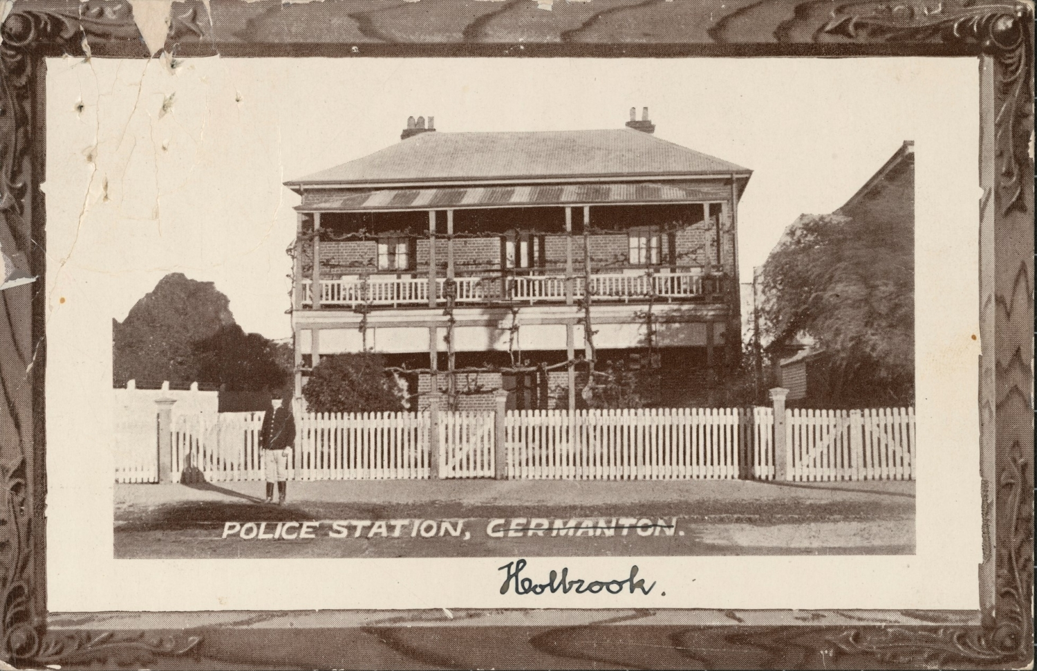 Black and white postcard depicting police station with hand written note saying Holbrook, with Germanton crossed out.