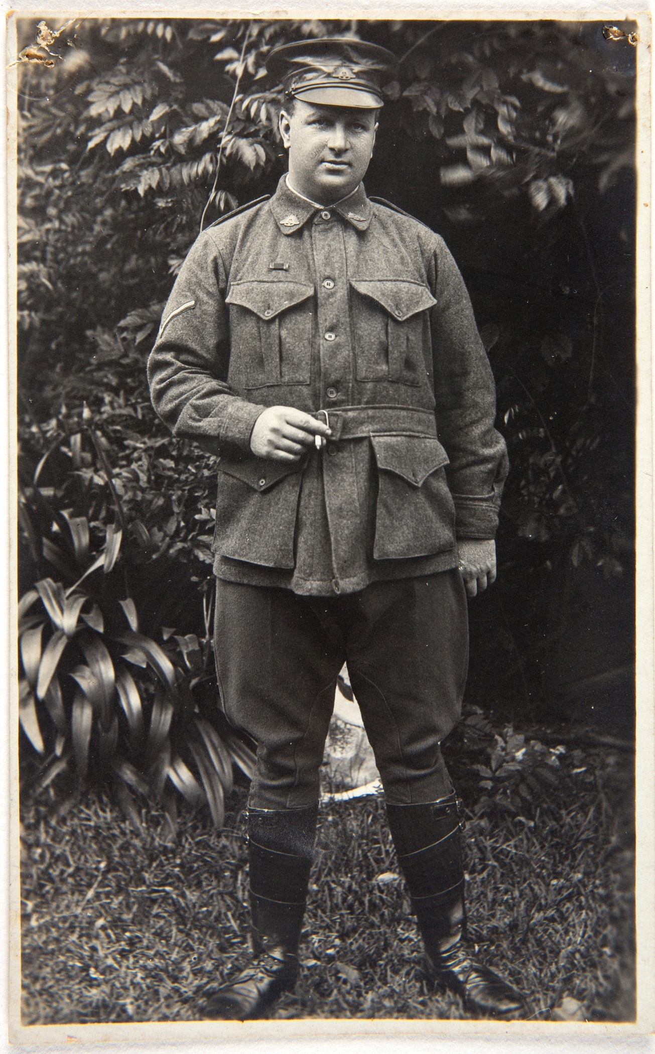 Black and white photo of man in uniform.