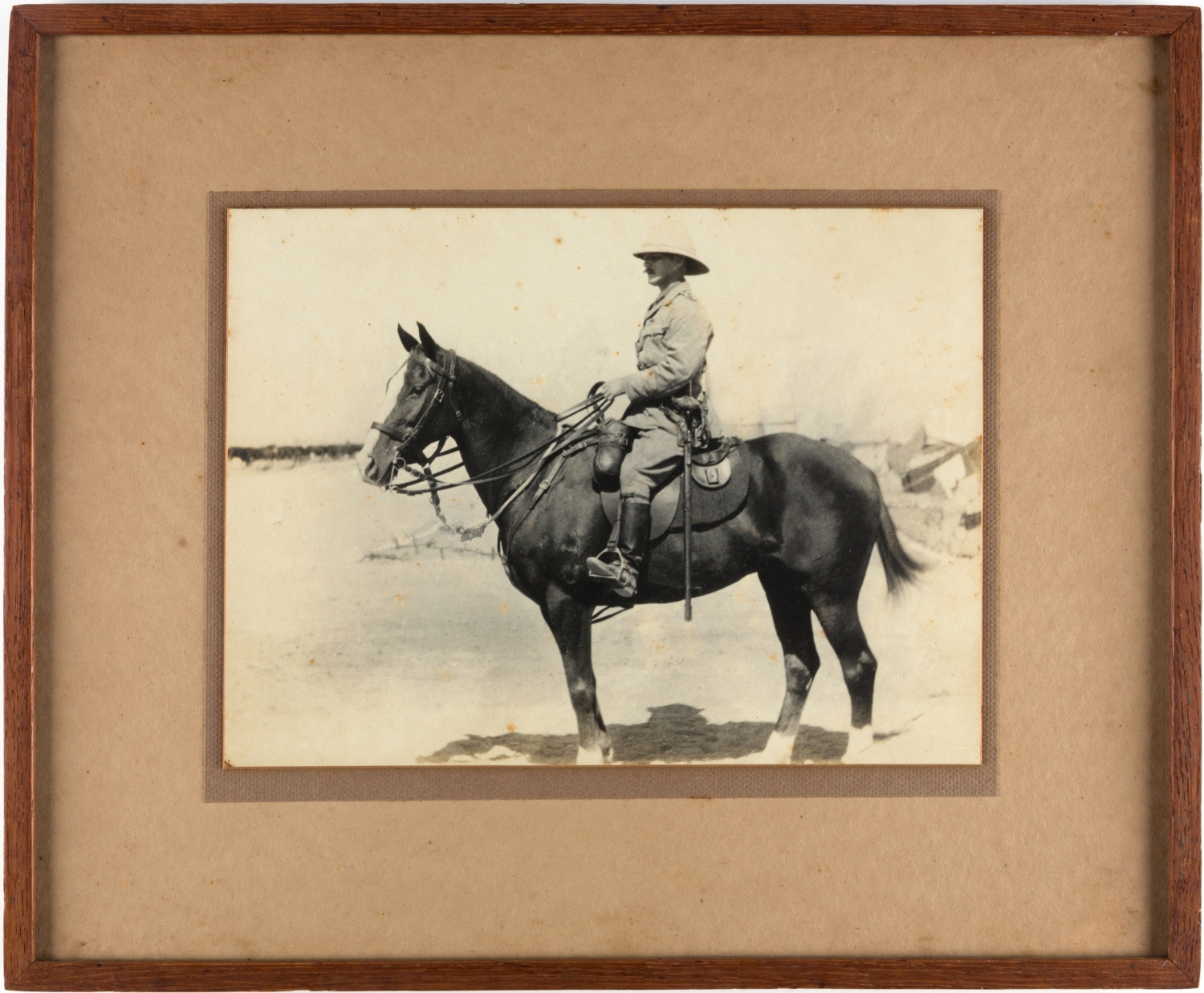 Frame with black and white photo of man on horseback.