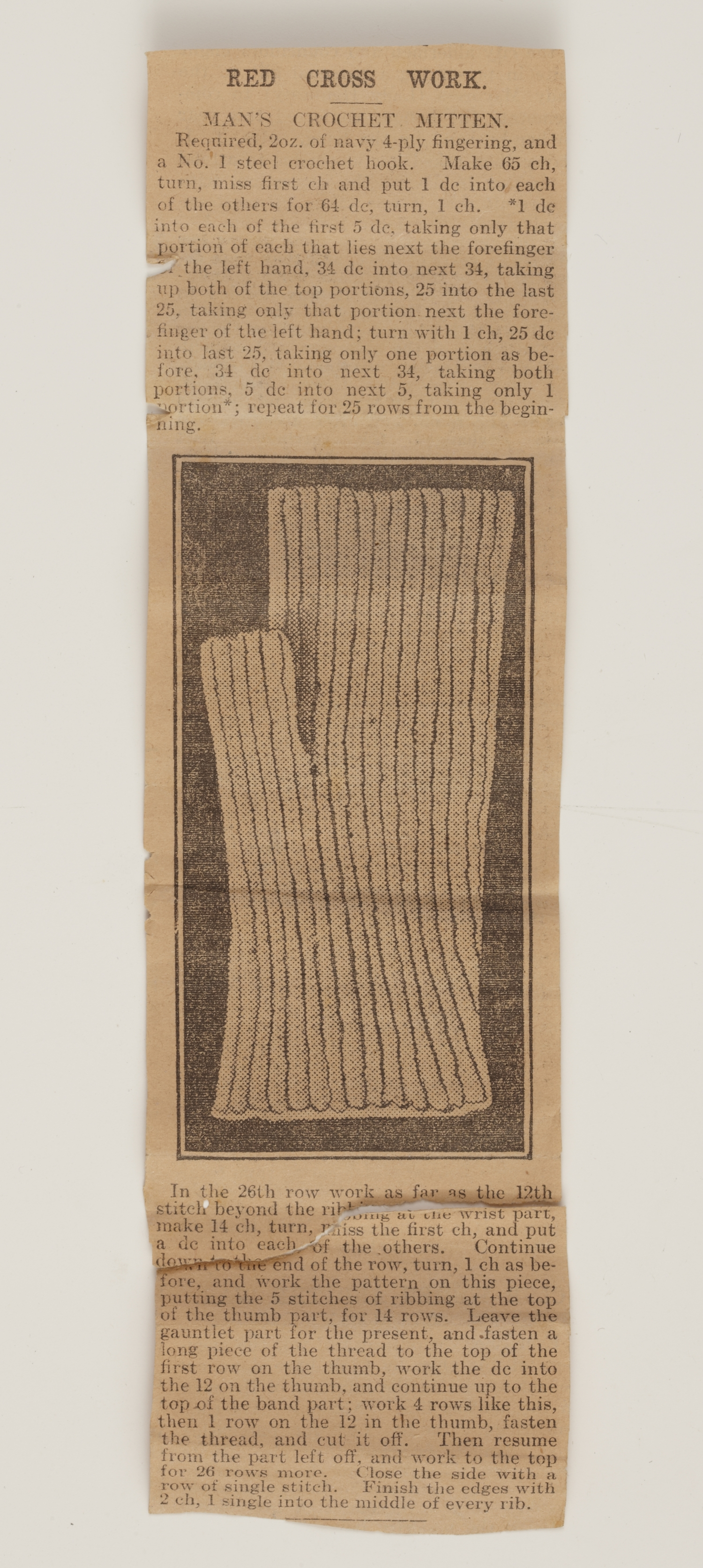 Newspaper photo of fingerless mitten