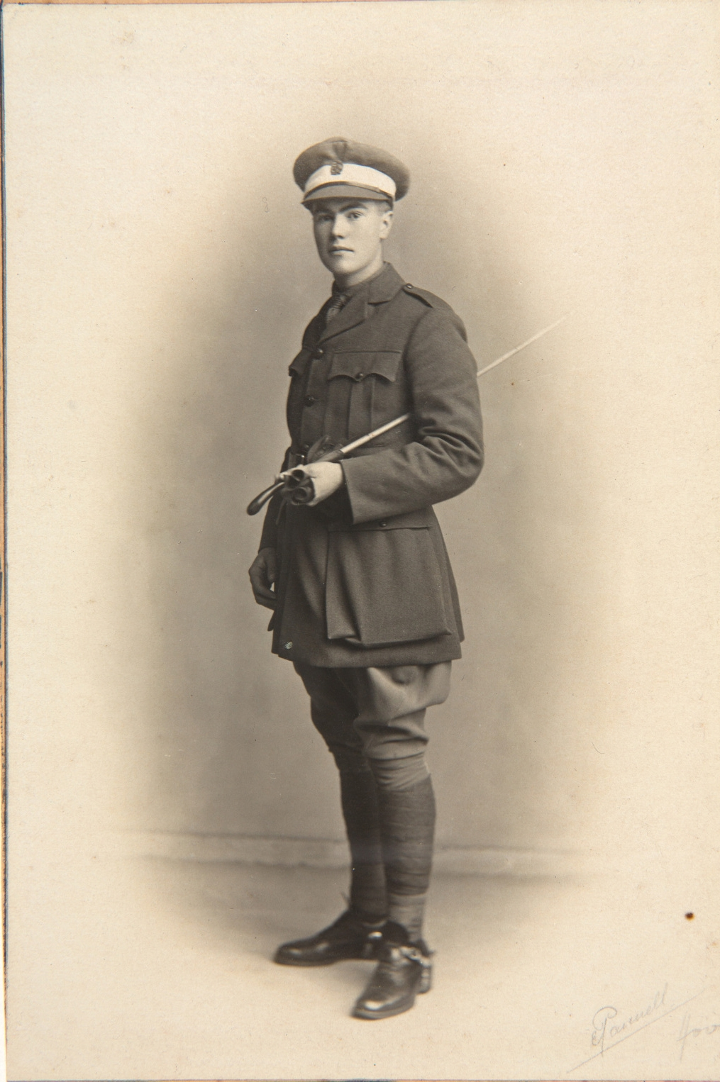 Sepia toned photo of man in uniform.