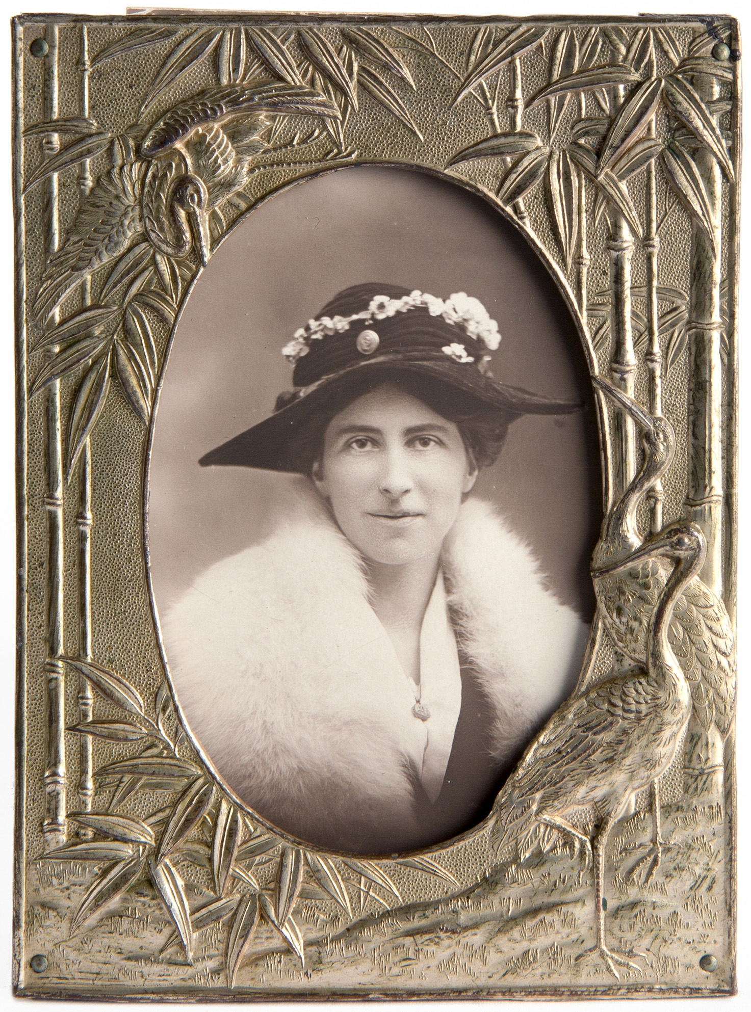 Framed platinum silver gelatin print of a woman wearing a hat trimmed with flowers.