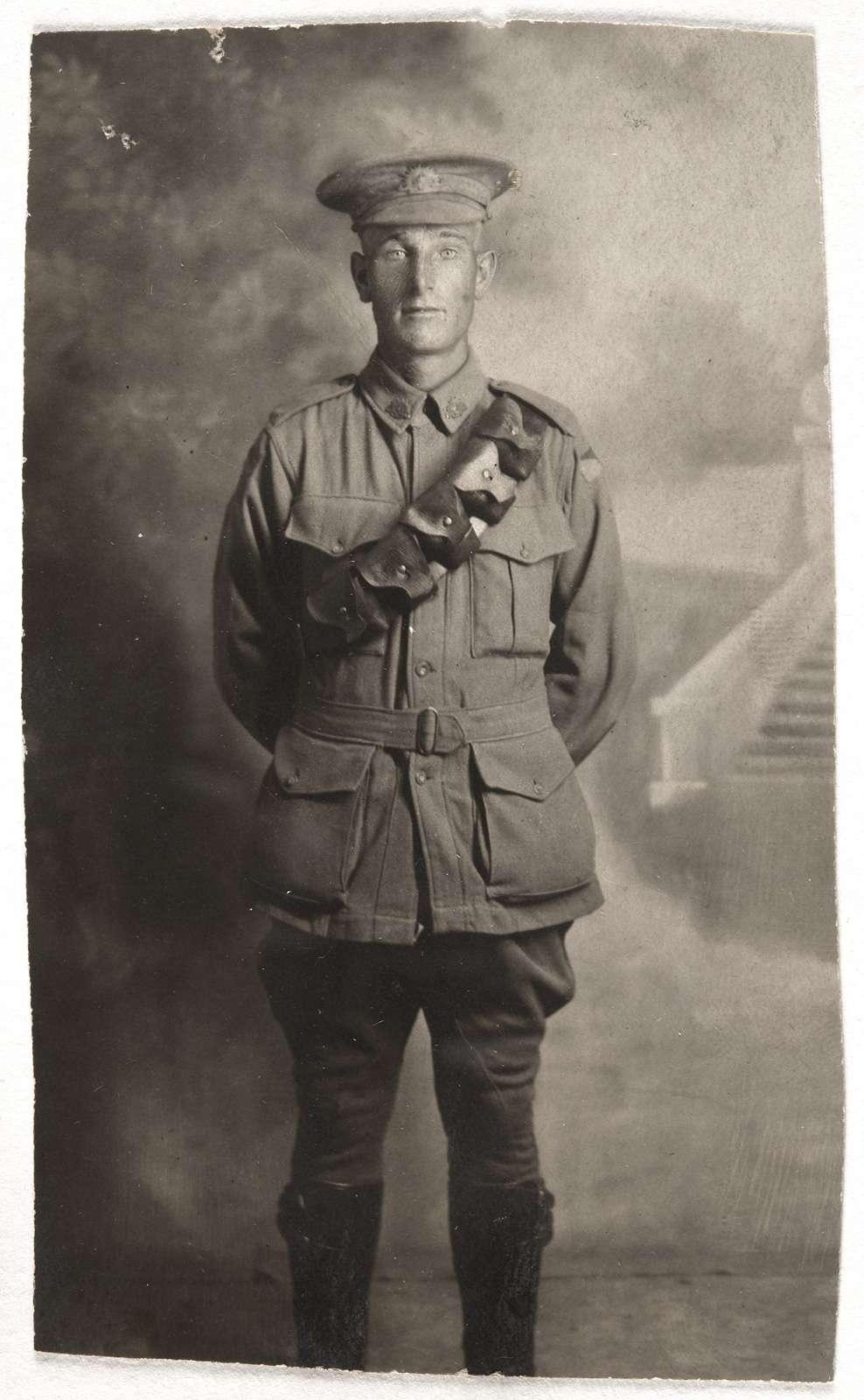 Black and white postcard of young man in uniform