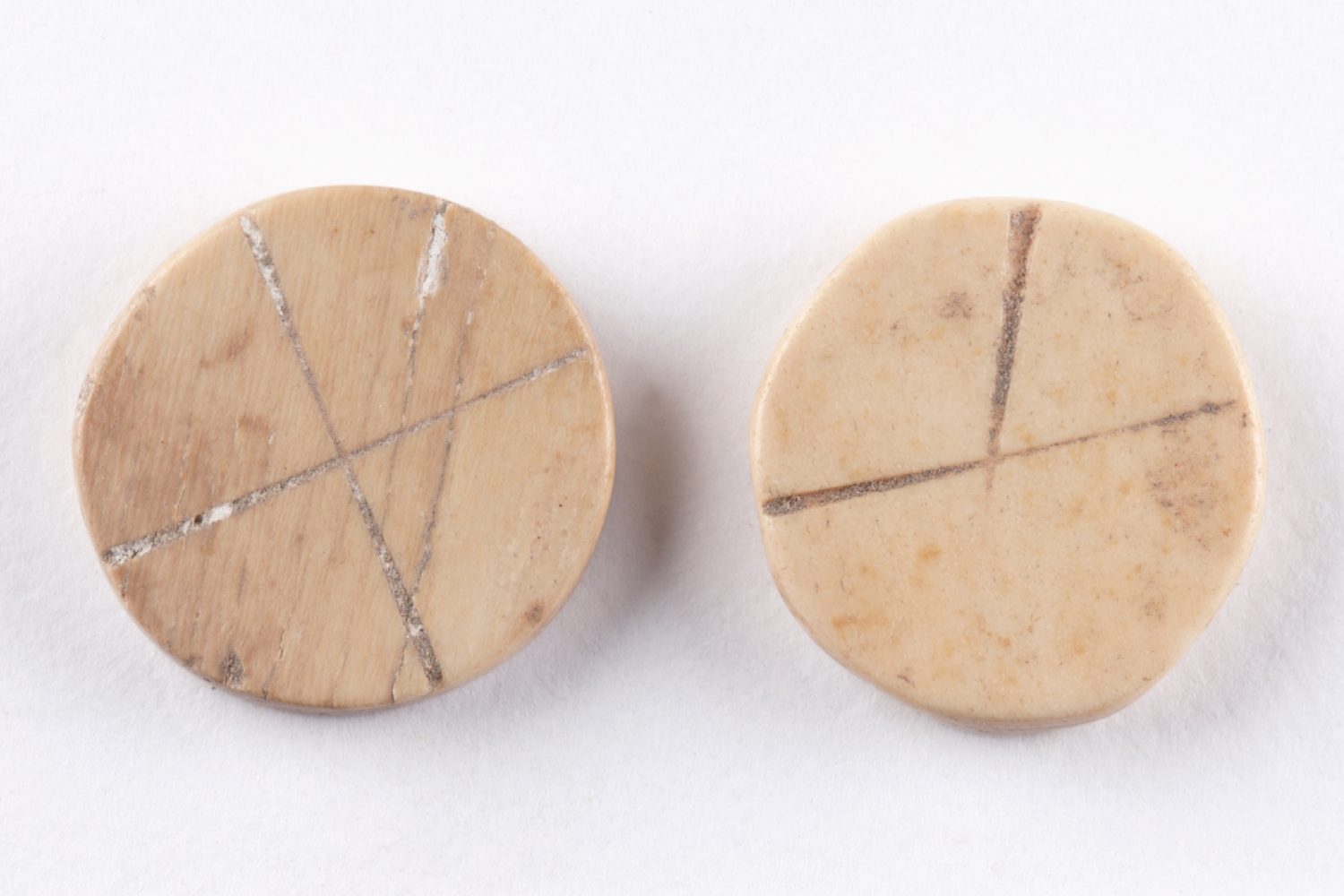 Two bone game pieces found underfloor at Hyde Park Barracks during archaeological excavations