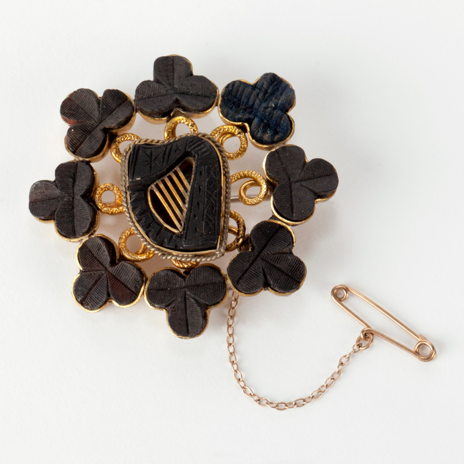 A gold and bog oak brooch. Made in Ireland, 1860s.