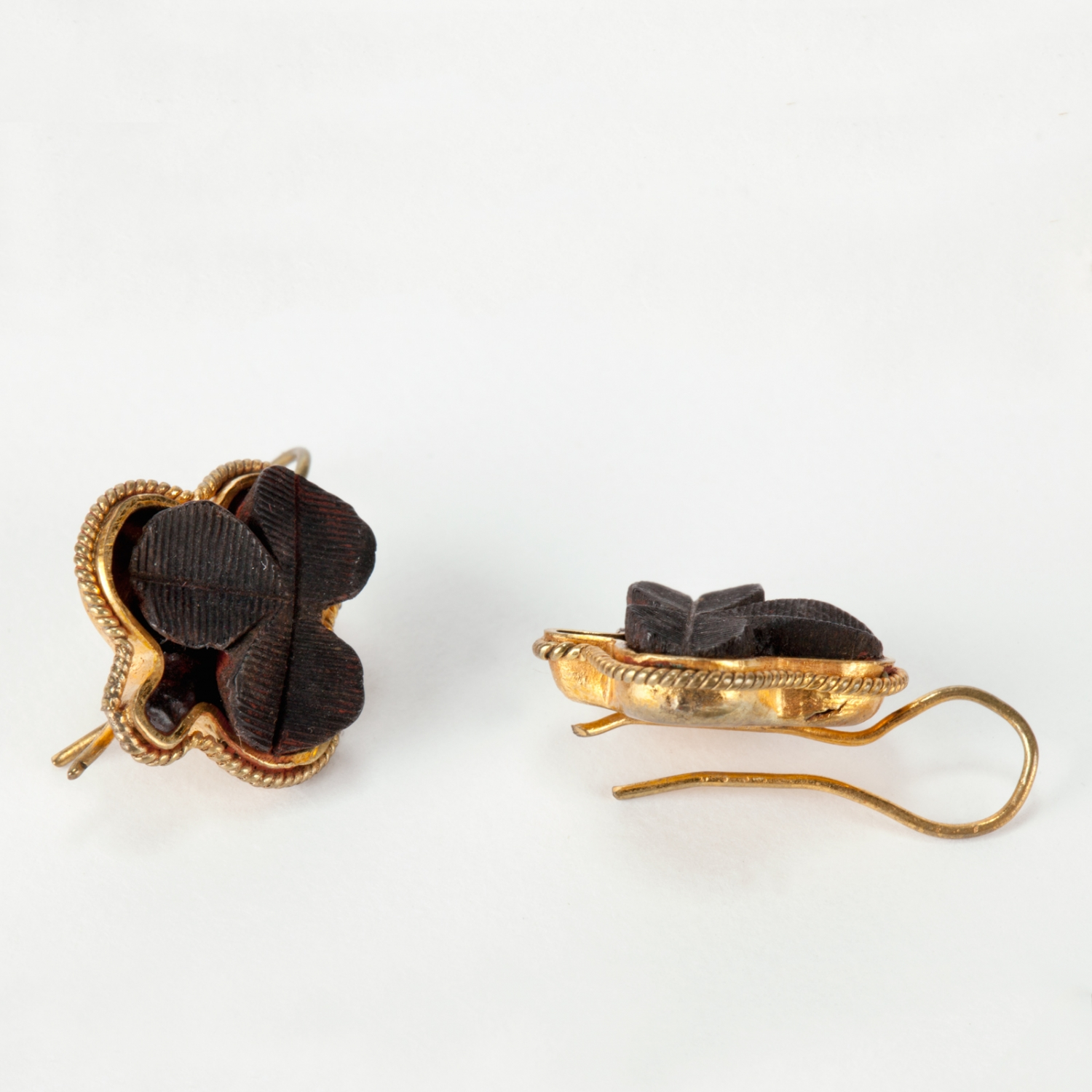 A pair of gold and bog oak earrings designed for pierced ears. Made in Ireland, 1860s.