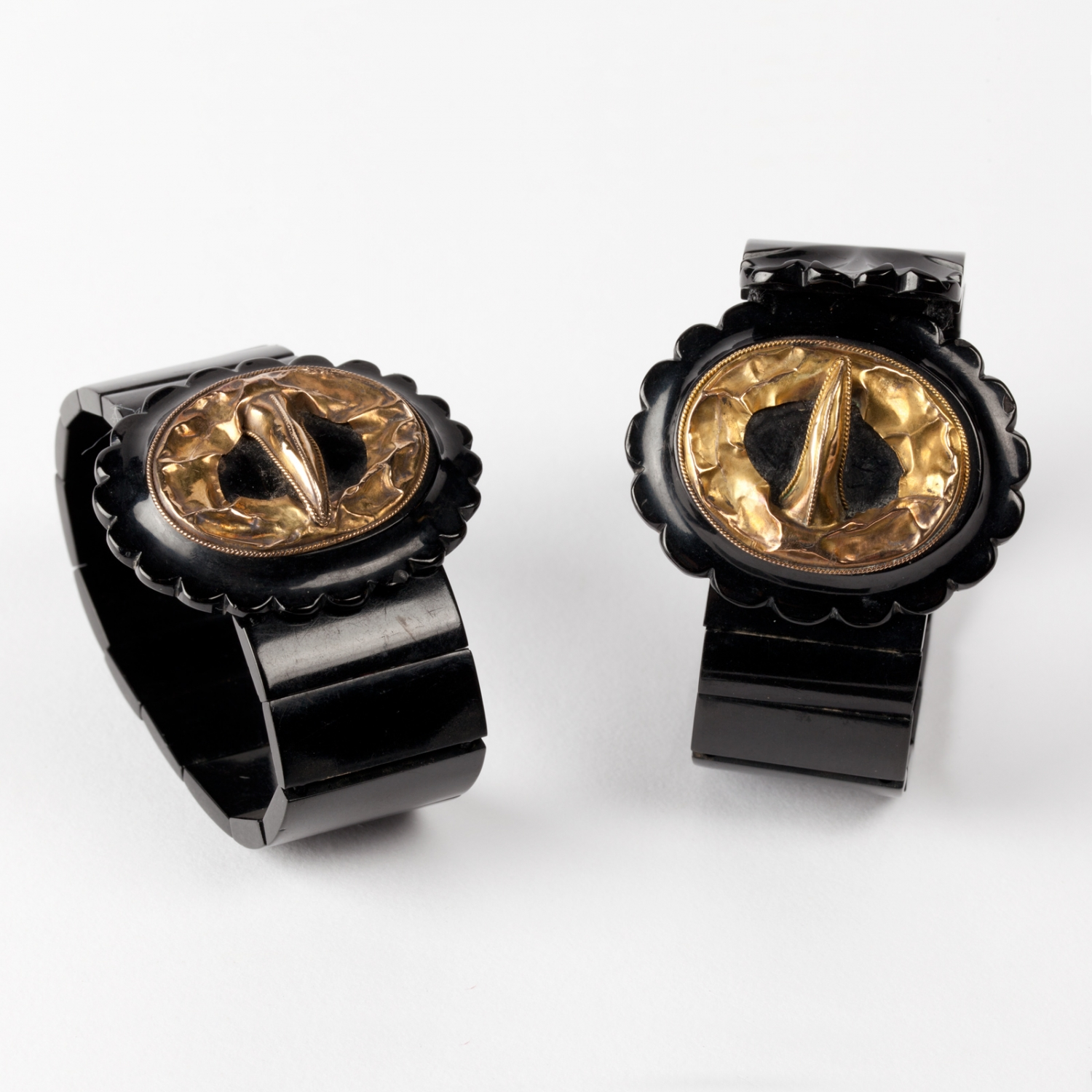 A pair of Whitby jet strap and buckle style bracelets, possibly incomplete. Made in England, 1860s.
