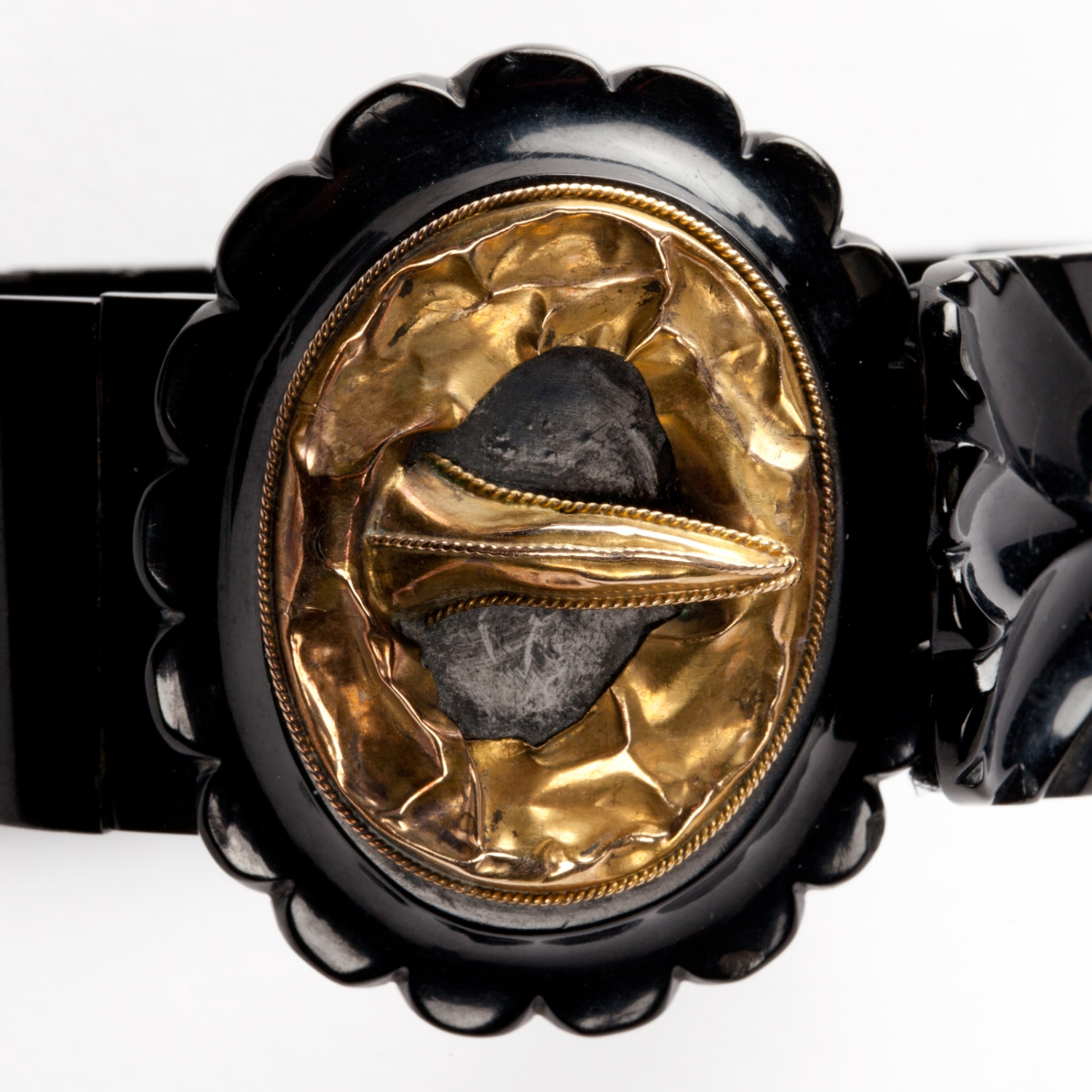 One of a pair of Whitby jet strap and buckle style bracelets, possibly incomplete. Made in England, 1860s.