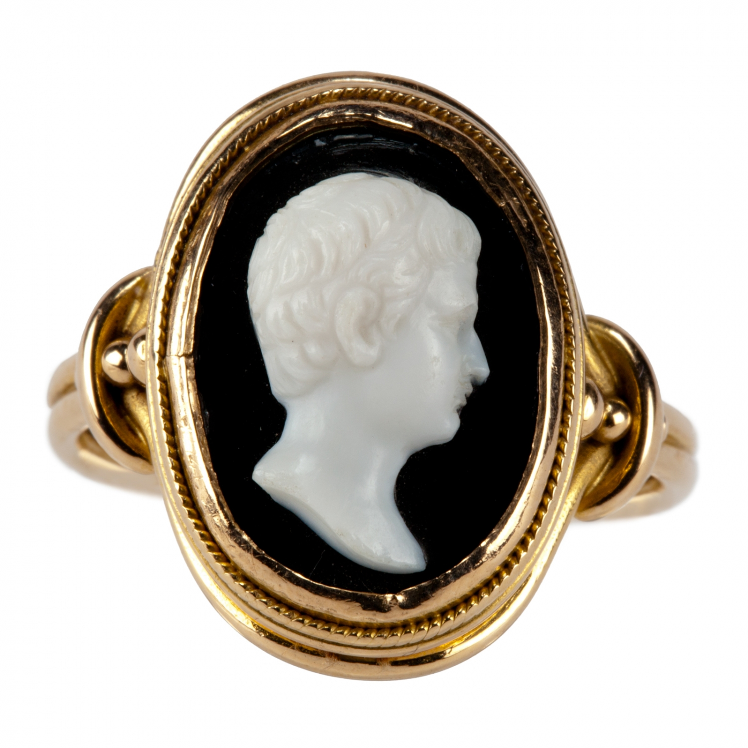 A gold ring set with an oval glass cameo of a classical male (Roman emperor Augustus) in profile. Made in Italy, 1867-1874.