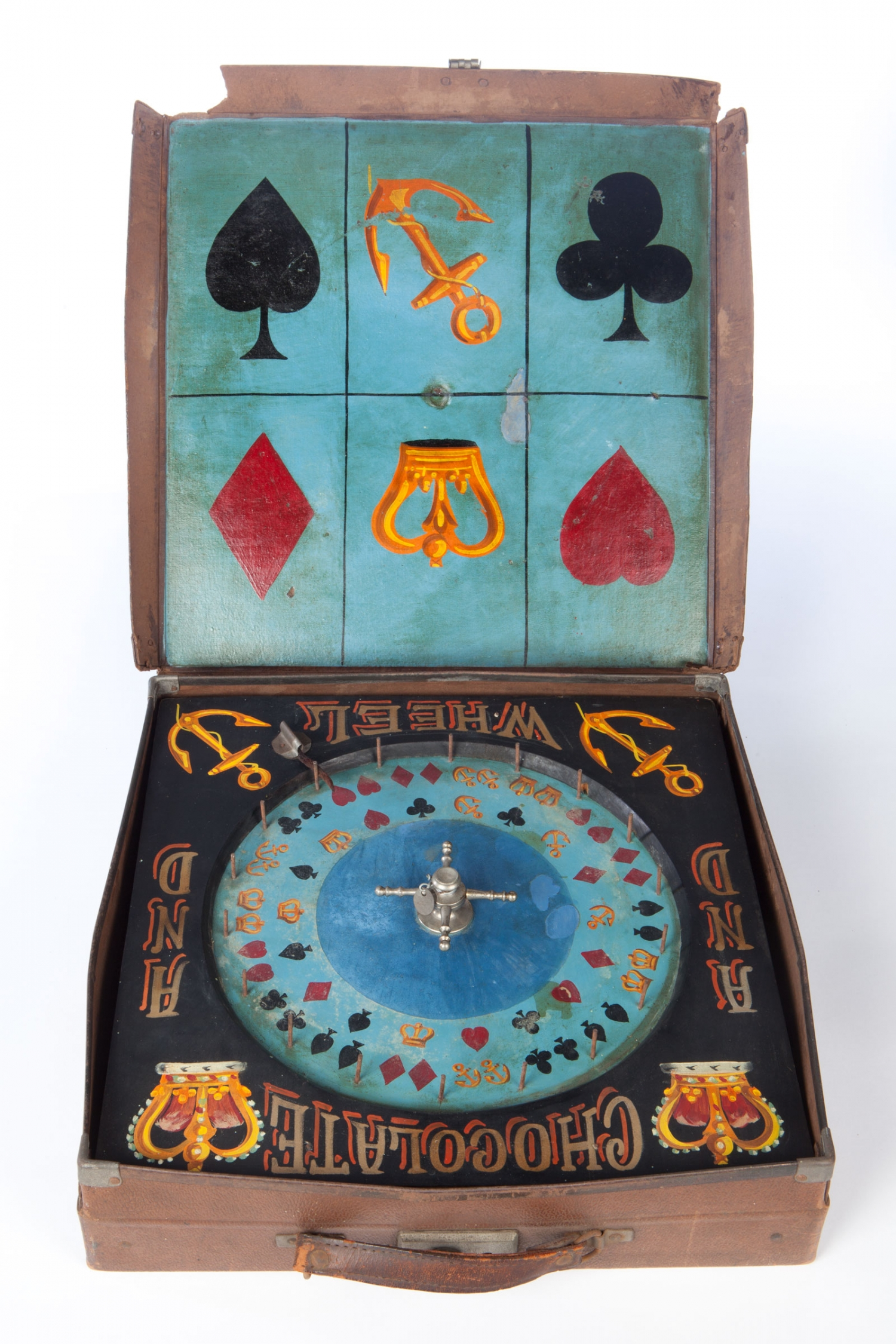 Brown cardboard 'suitcase' containing a Crown and Anchor Chocolate Wheel, circa 1914