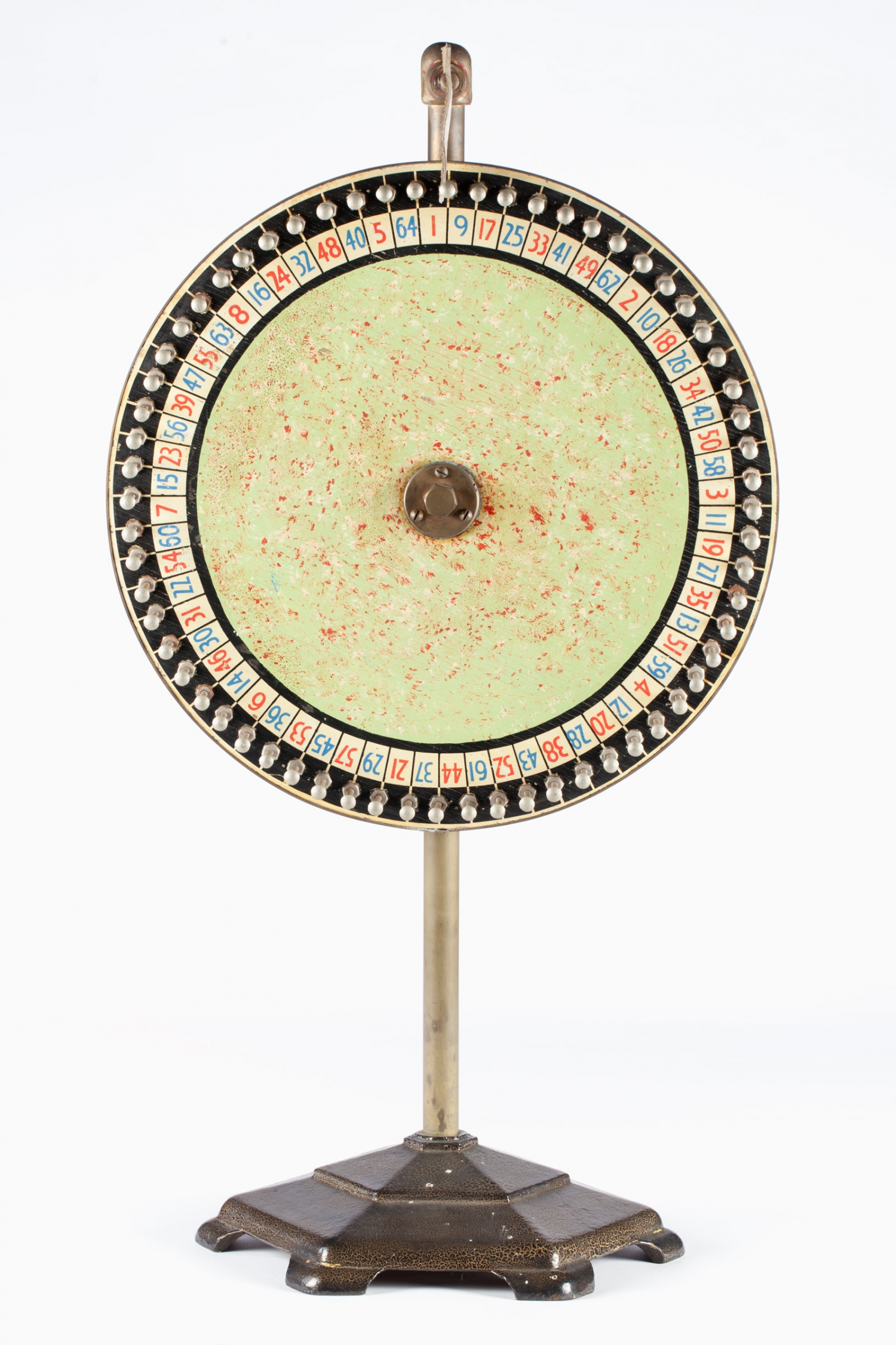 Circular wheel, or Chocolate wheel, on a cast metal stand, mid 20th century