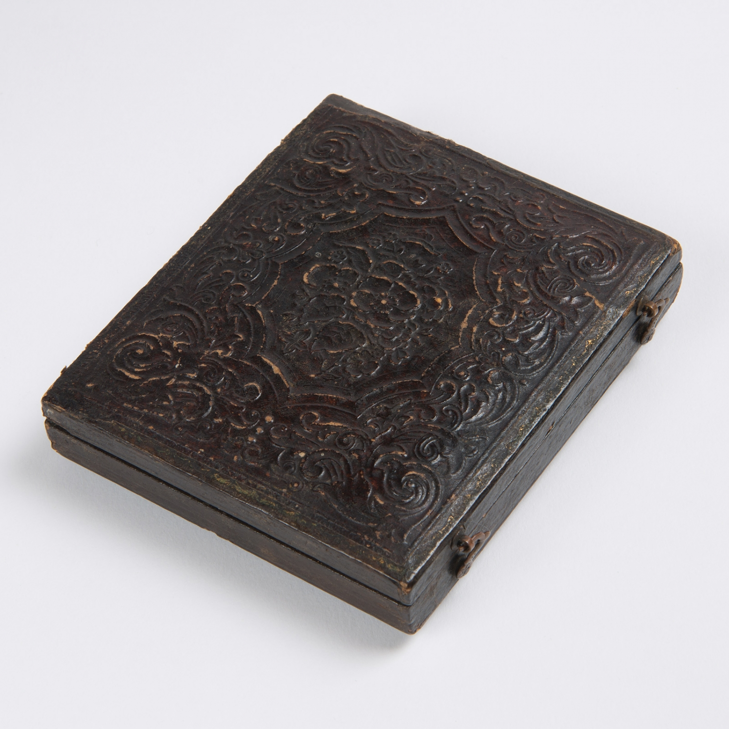 Case with floral decoration, containing an ambrotype portrait photograph of Kenneth McKenzie, circa 1860