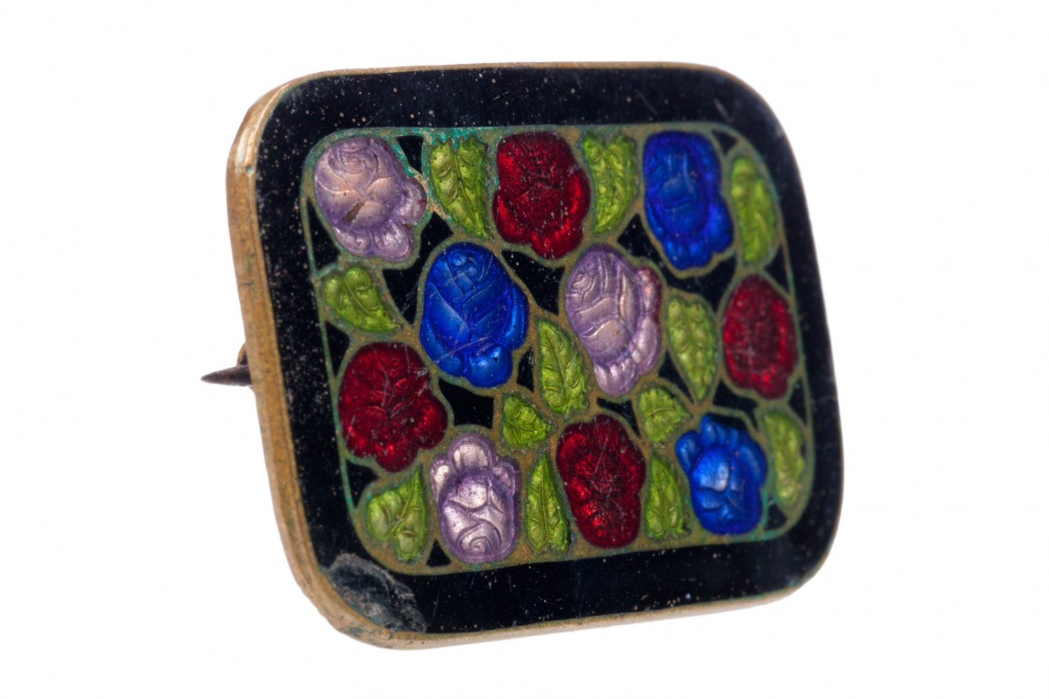 A brooch made of cloisonné enamel on brass with a design of blue, pink and red flowers and green leaves