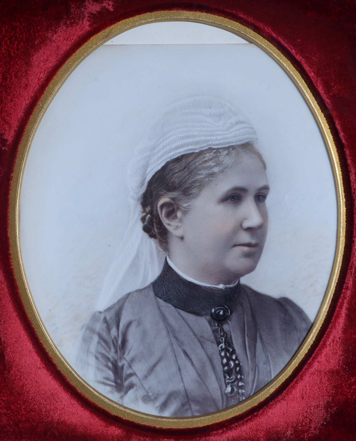 Tinted portrait photograph on opal glass of Elizabeth Buchanan.