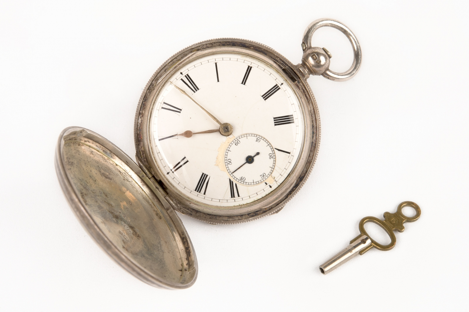 Pocket watch and winding key, circa 1863, belonging to Hugo Youngein who operated shop at Susannah Place