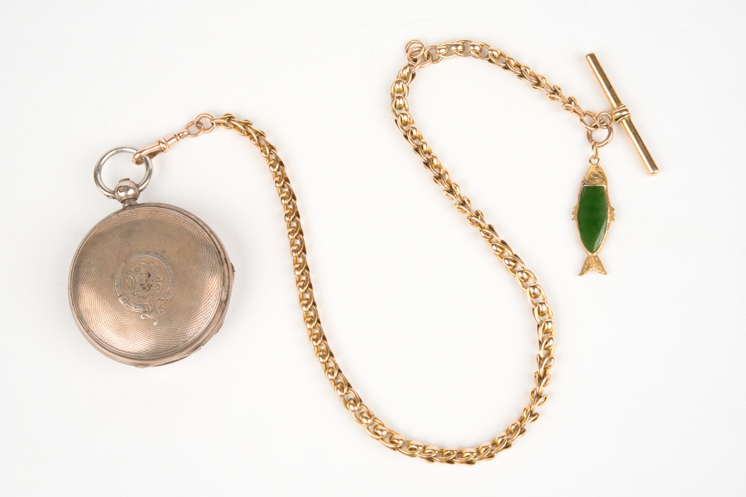 Pocket watch and watch chain with small jade fish attached, owned by Hugo Youngein who operated shop at Susannah Place