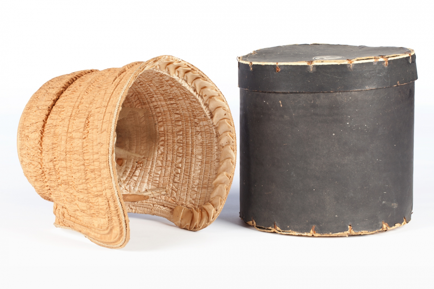 This is an example of a drawn bonnet and hat box.