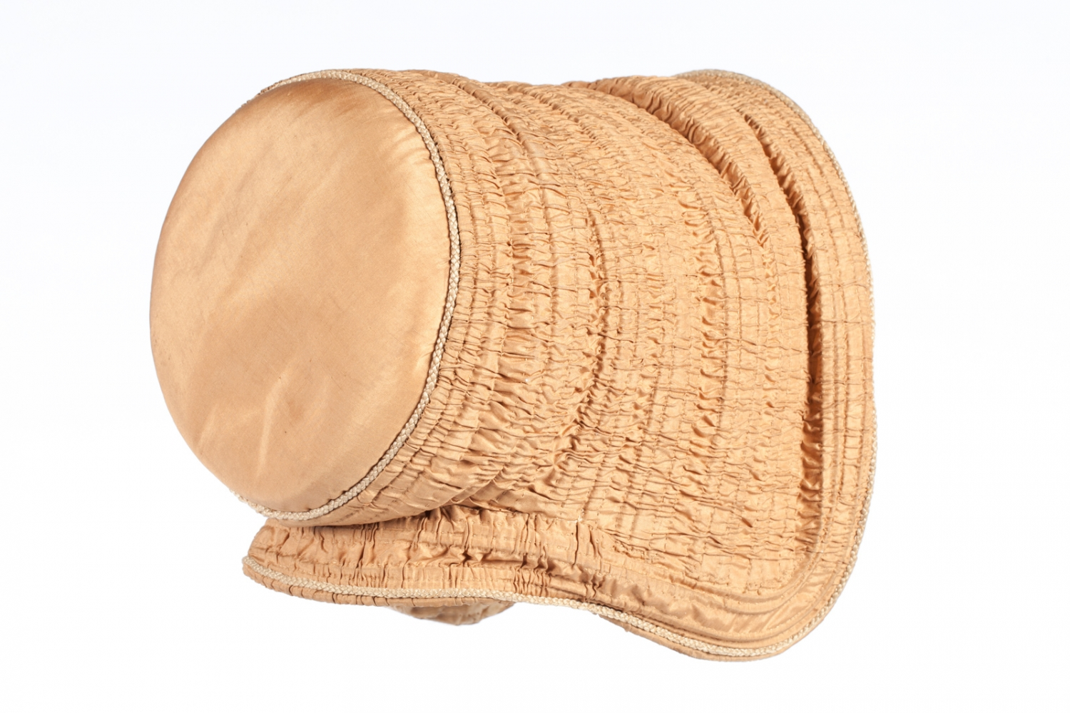 This is an example of a drawn bonnet, a bonnet where fine fabric is ruched - or drawn - over a series of supports, usually cane or whalebone hoops