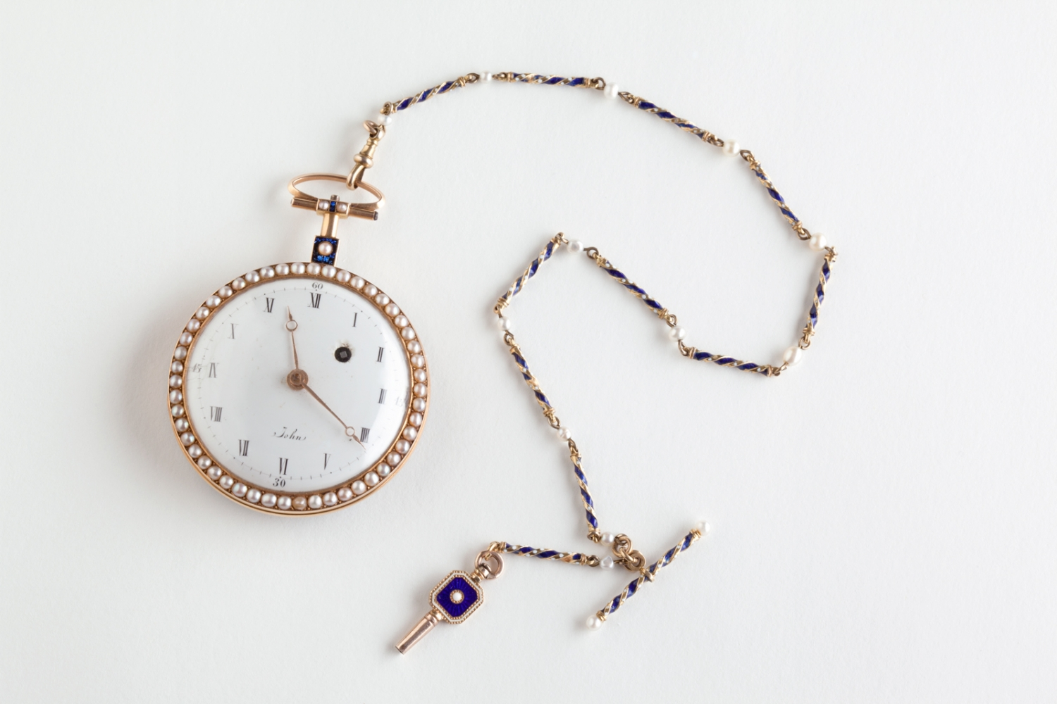 Face of pocket watch with white enamel dial, circa 1816