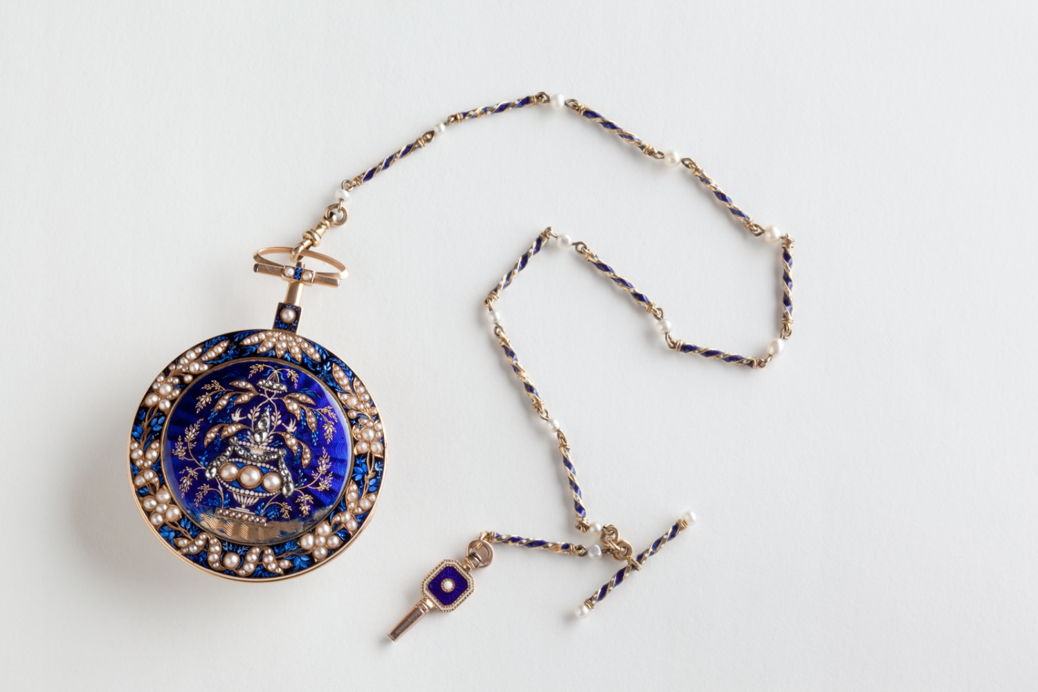 Back of pocket watch set with half pearls and rose cut diamonds on blue enamel ground, circa 1816