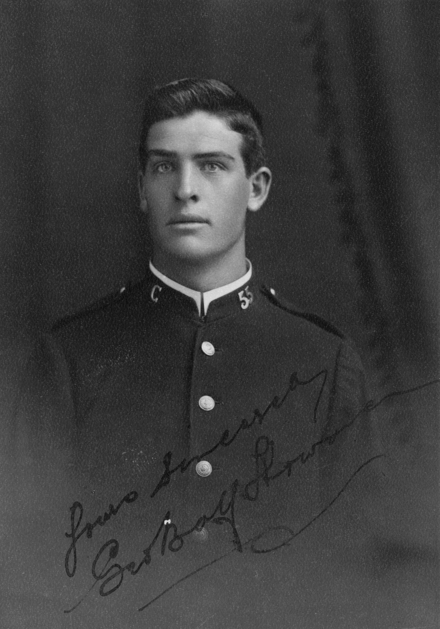 Black and white portrait of young man in uniform.