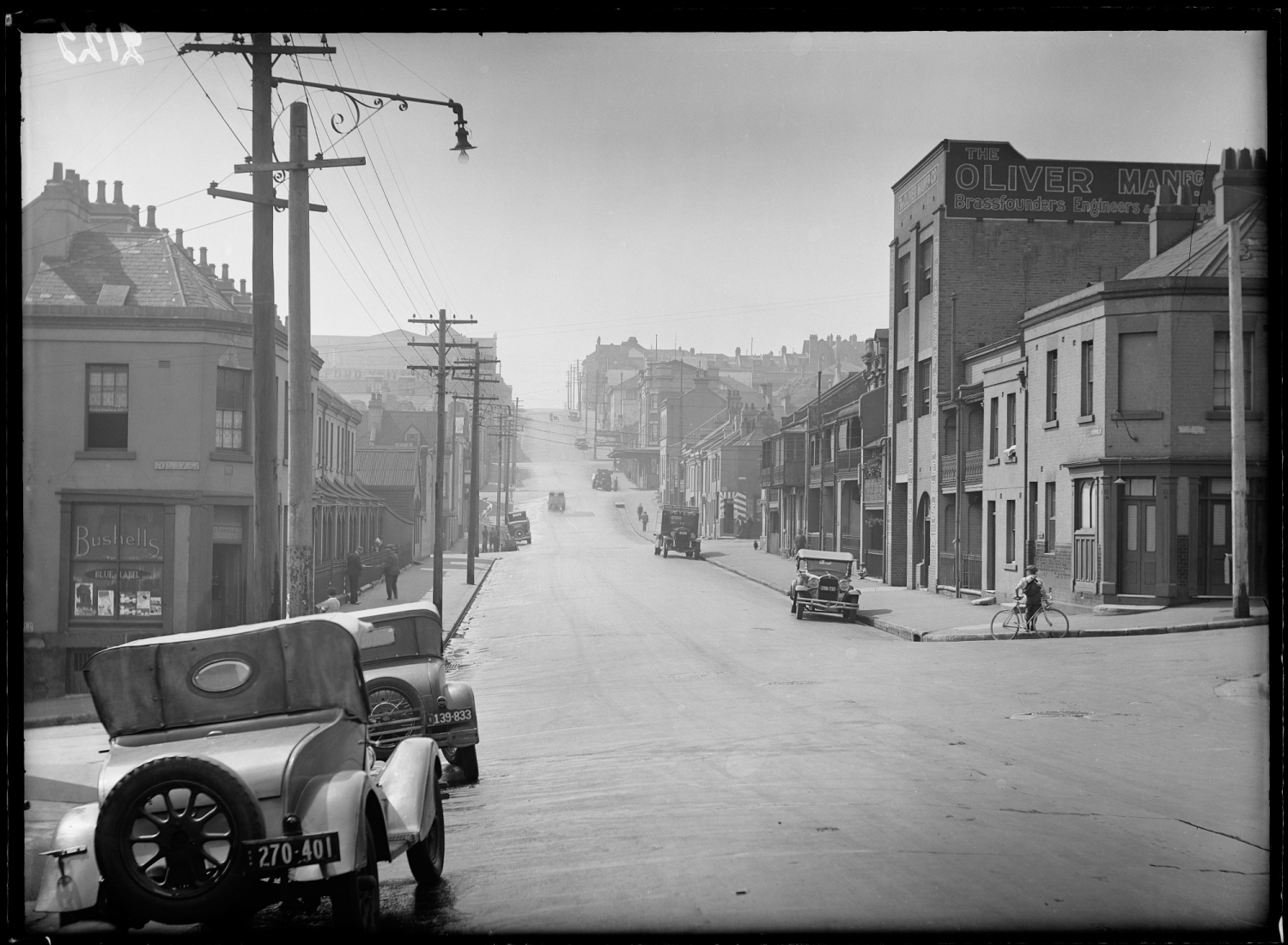 Liverpool Street, Riley Street intersection, Darlinghurst, looking east, Sydney, c1930