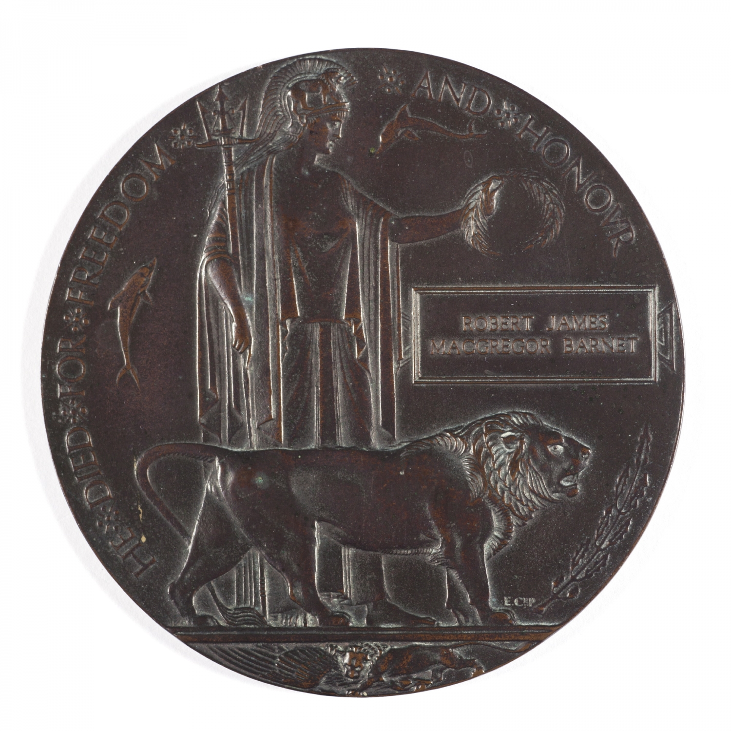 Round metal medallion with relief image.
