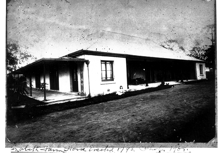 Black and white photo of homestead.