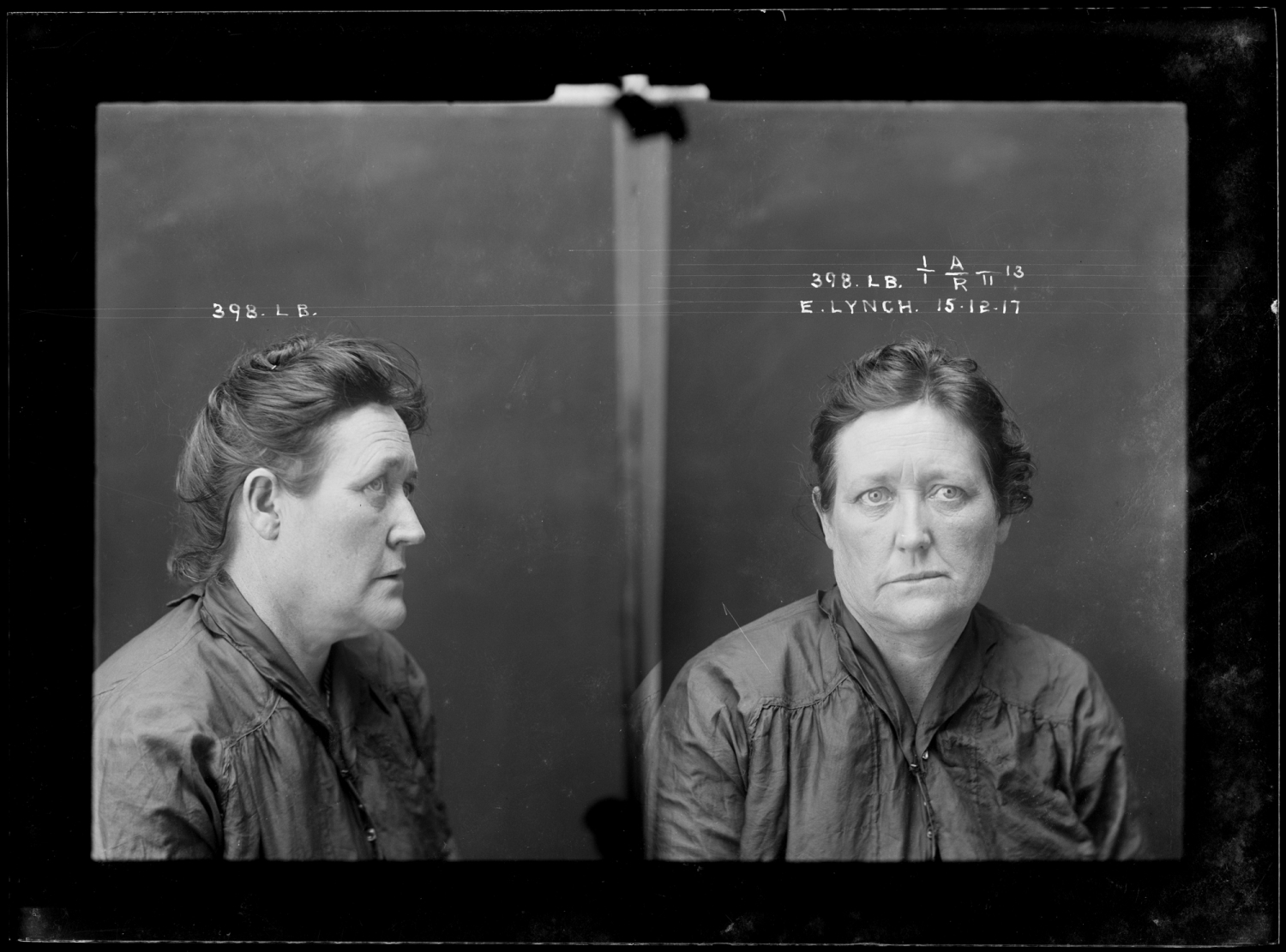 Side and front view mug shot of woman with hair up. Black and white photo