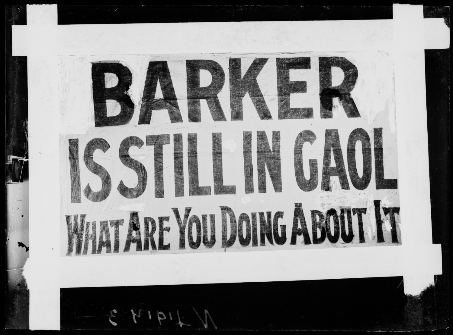 "Sign reading ""Barker is still in Gaol. What Are You Doing About It?"""