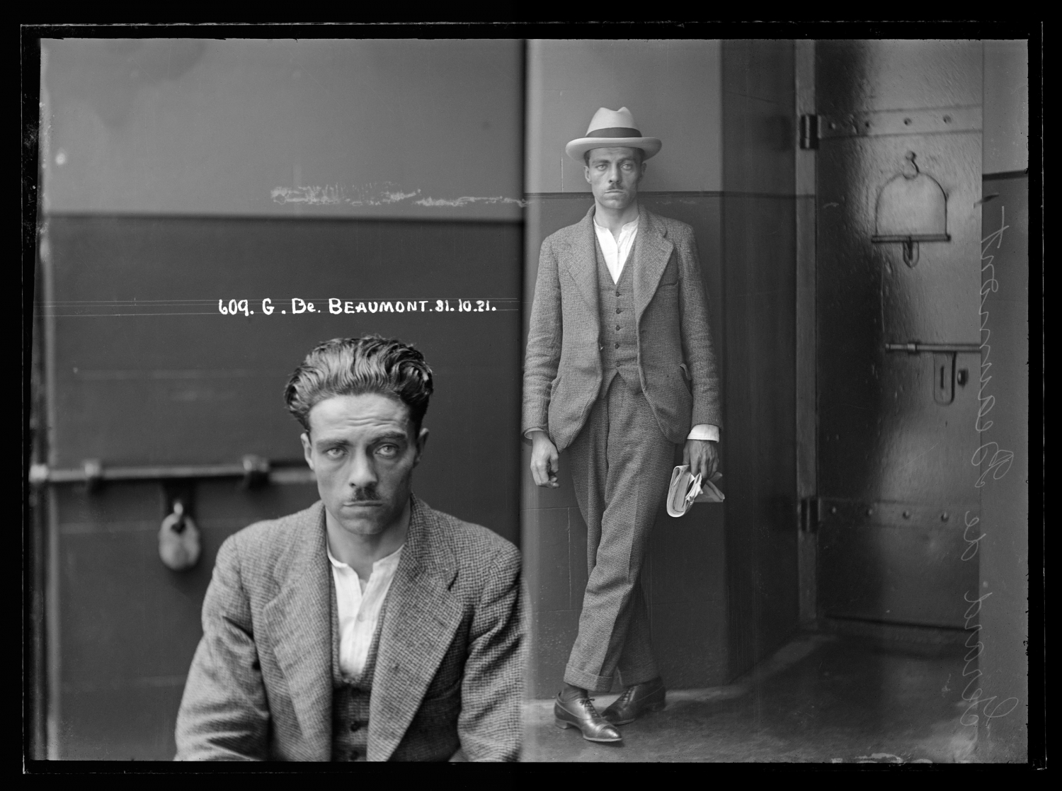 Black and white dual mugshot; man, seated on left, standing with hat on on right.