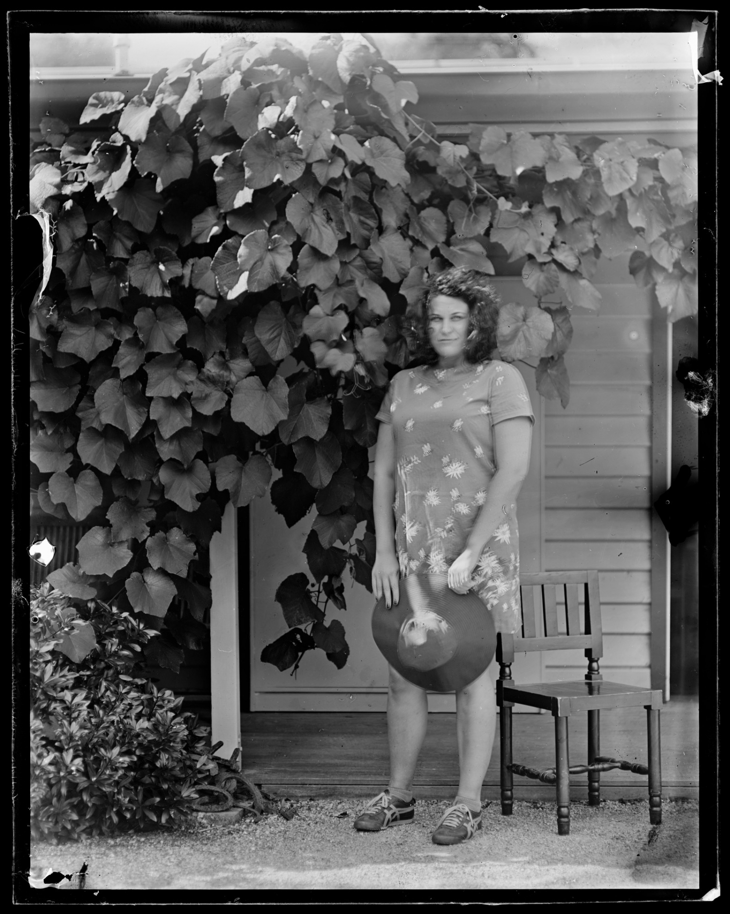 Black and white photo of woman in garden.