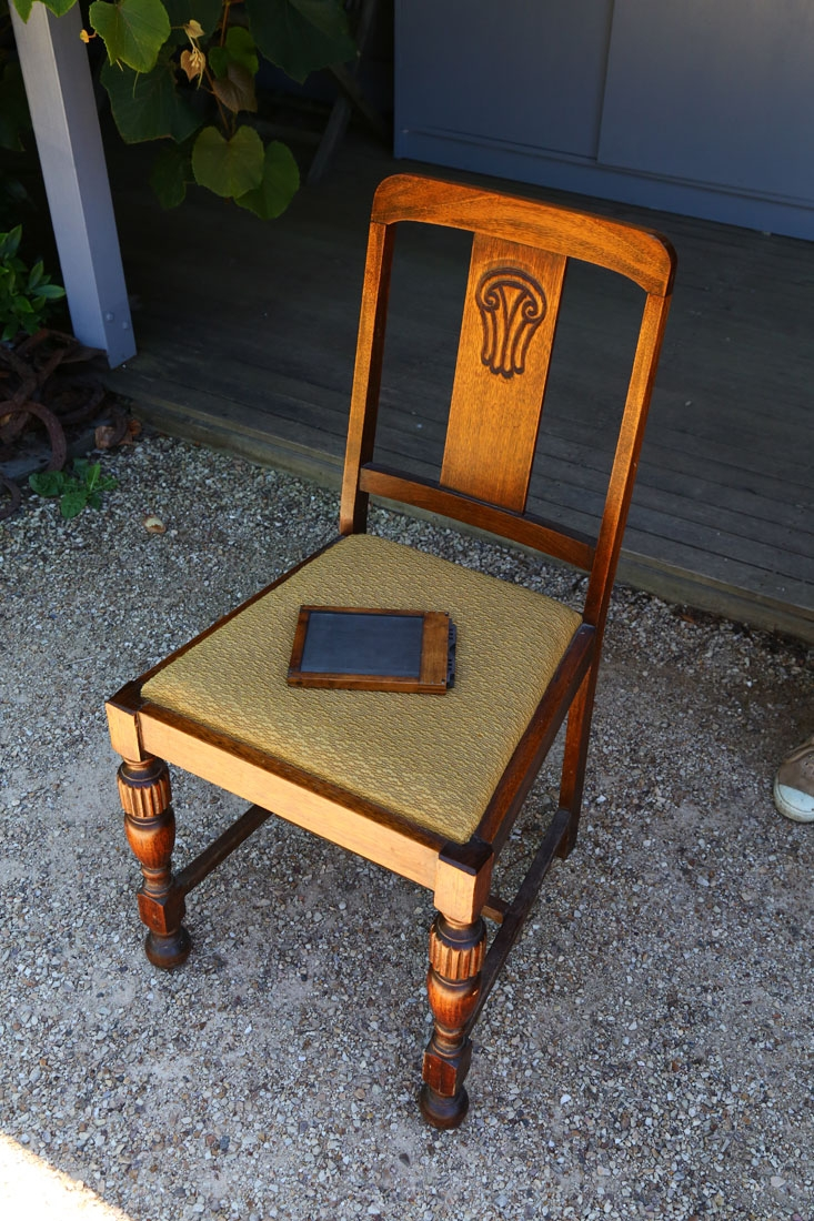 Chair with glass plate holder.