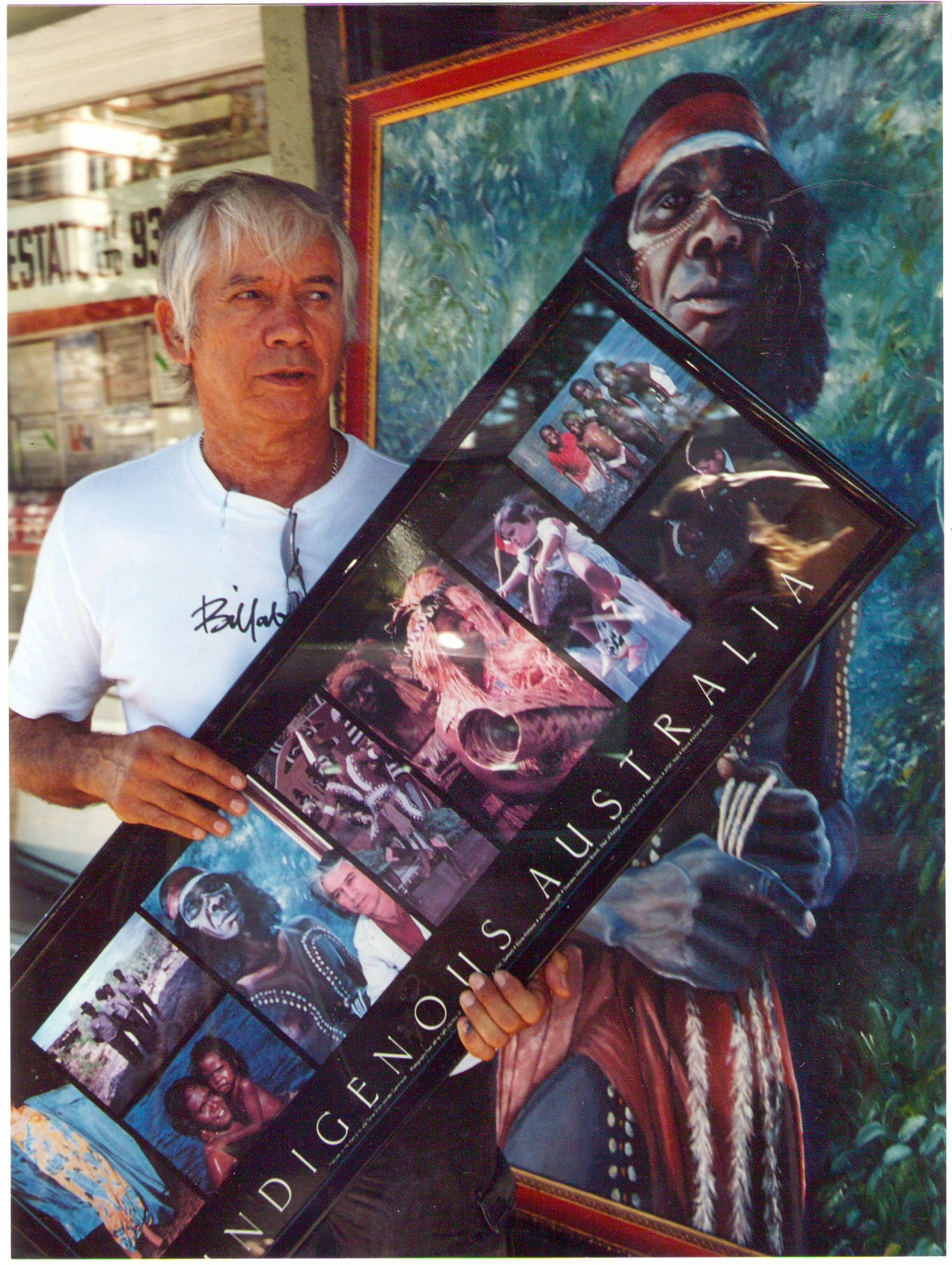 Man holding poster of artworks.