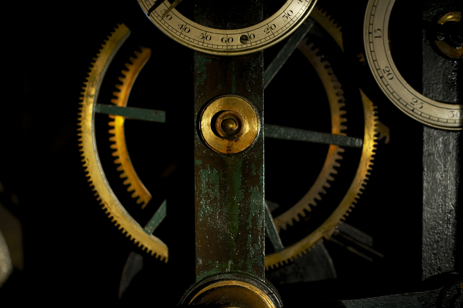 Closeup of the Barrack's clock movement cogs and gears with numerals partly visible.