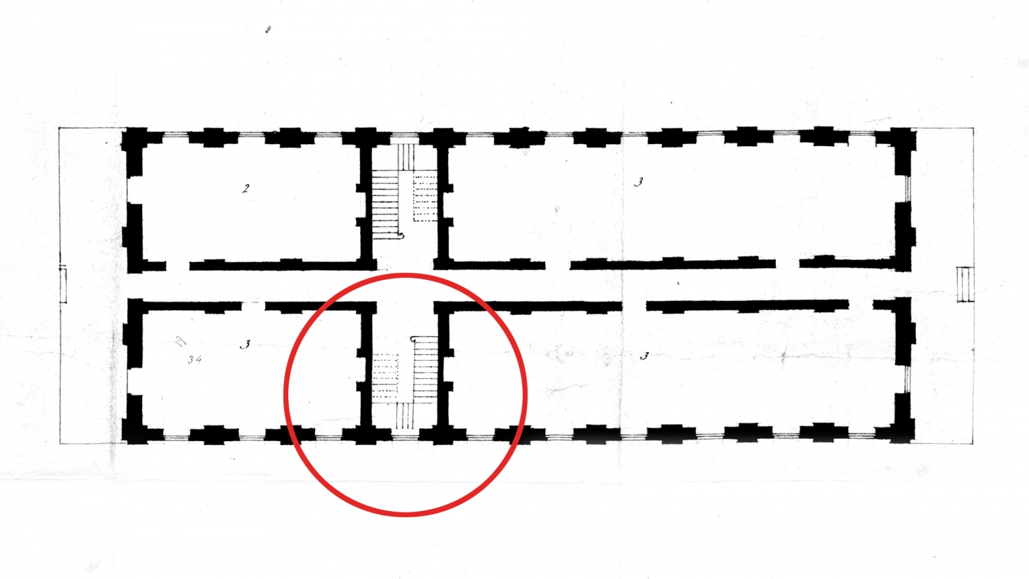 Plan of building with red circle superimposed over part of it.