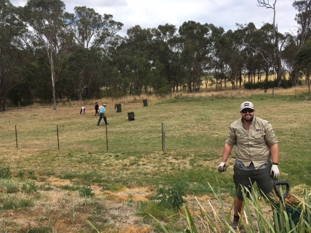 Dominic and SLM staff helping out with some weeding at the Rouse Hill working bee