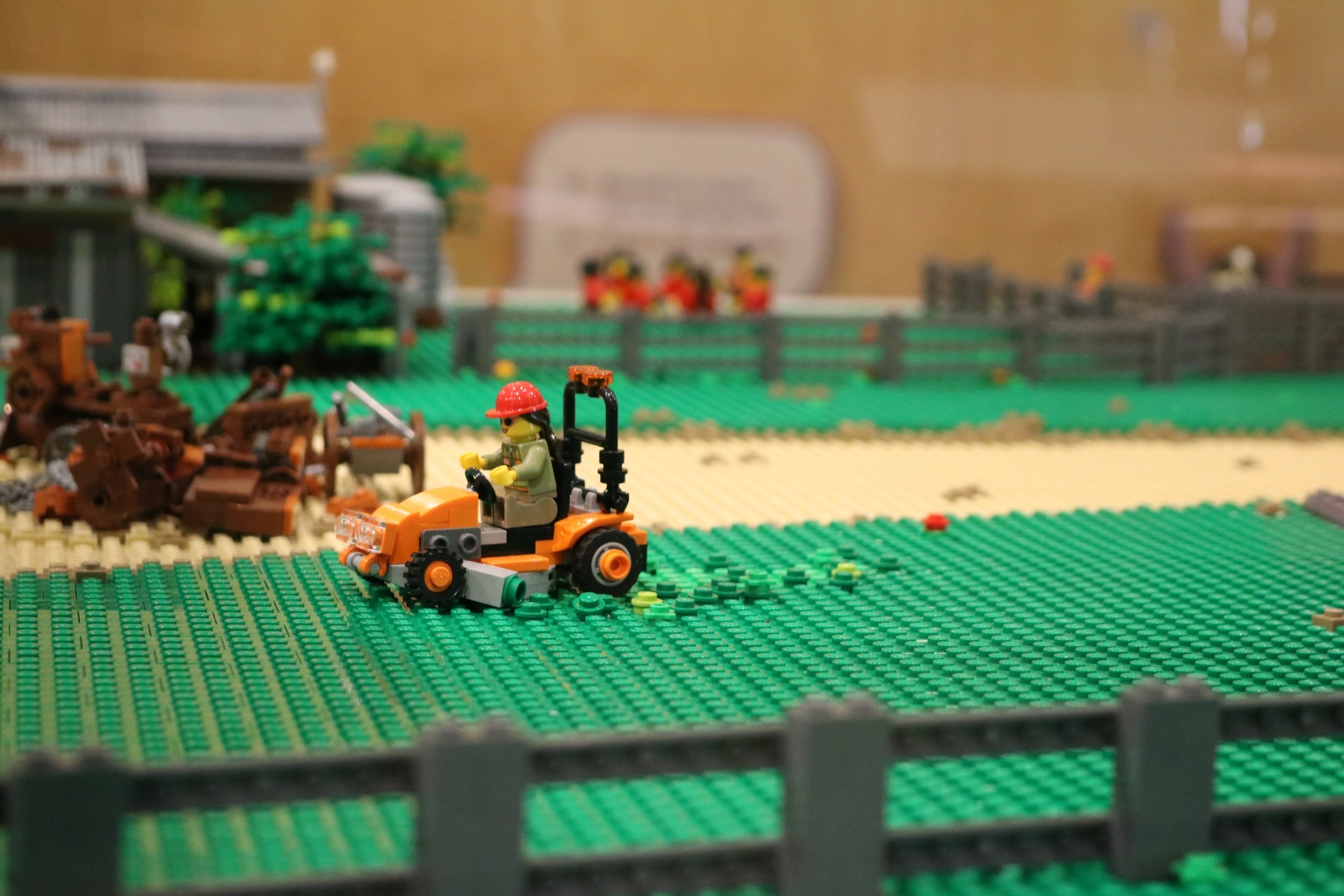 A garden team member on a ride on mower in the Rouse HIll House and Farm LEGO© replication
