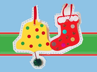 Two decorated Christmas ornament shapes - a yellow bell and a red stocking - with ribbon for hanging them.