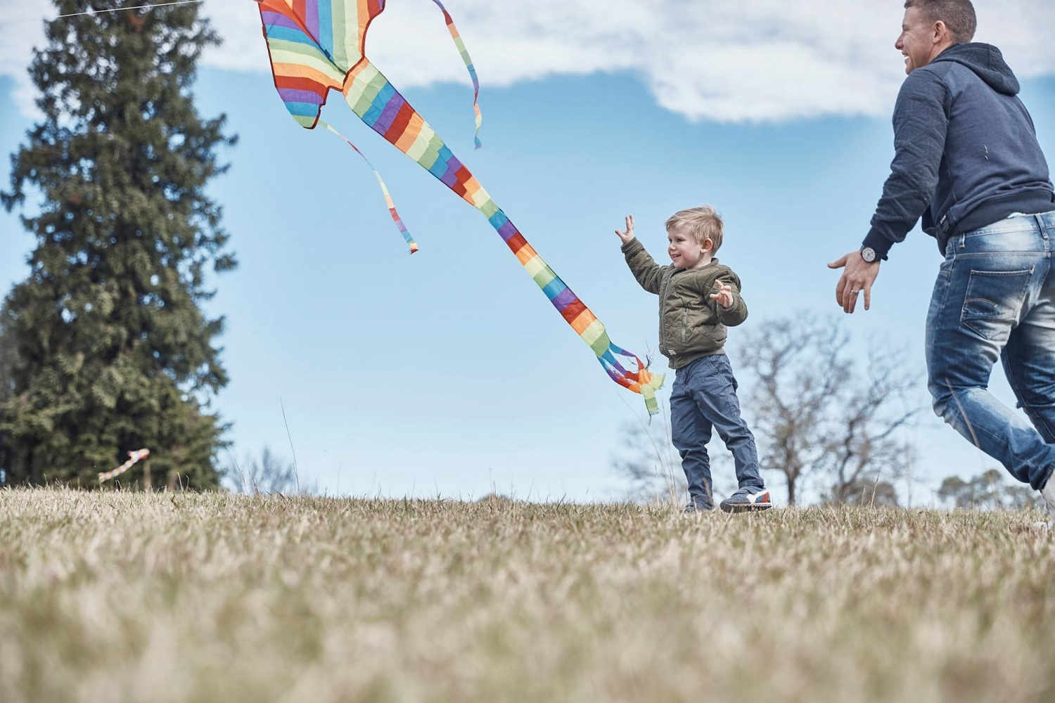 Two children flying a kite.