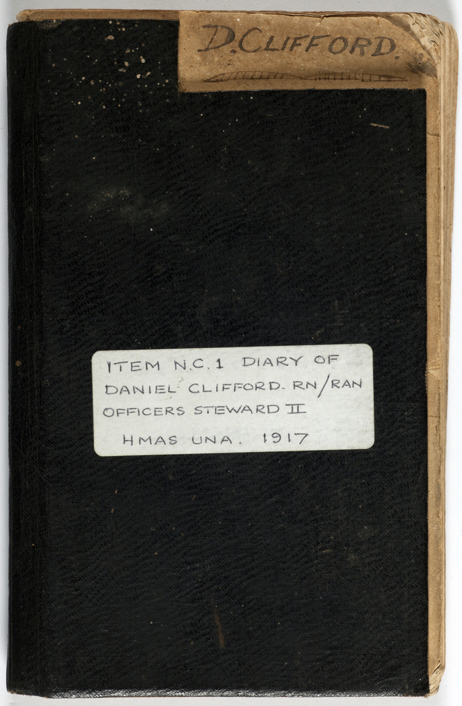 Leather cover of diary with white sticker on front.