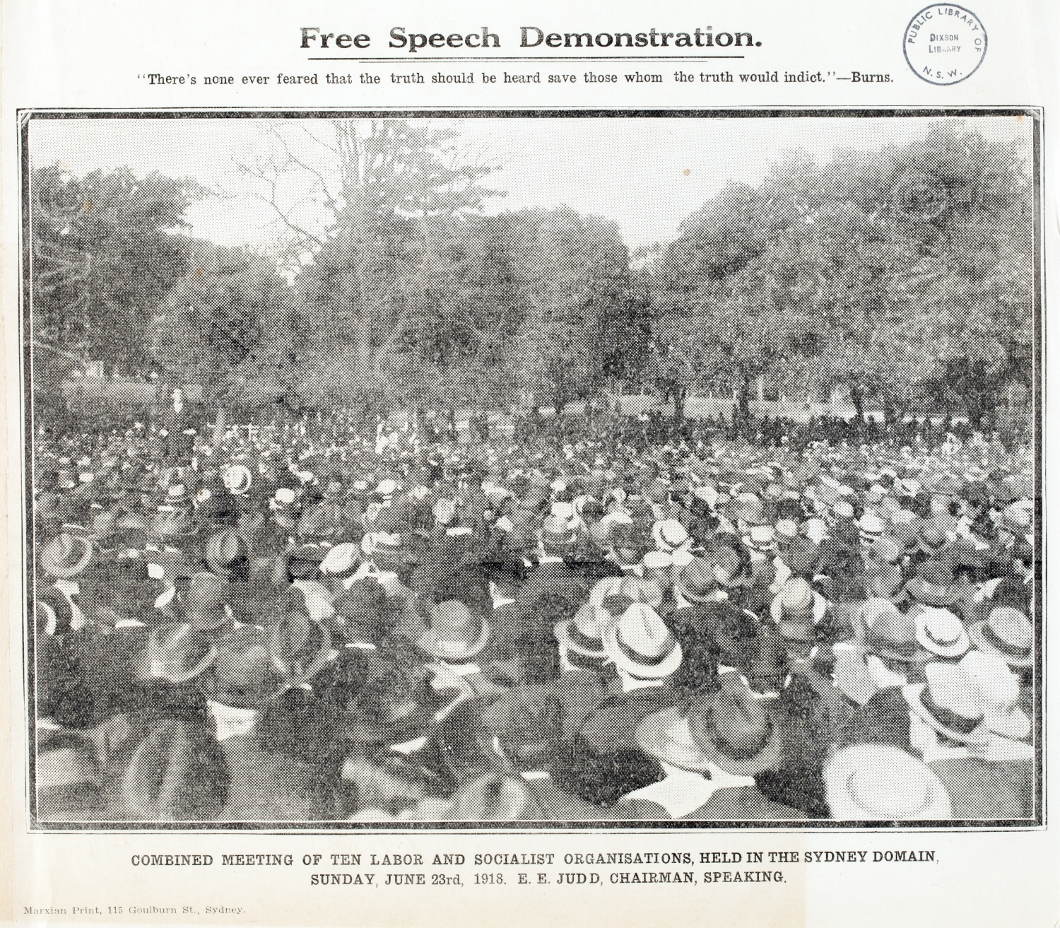 Newsprint photo of large crowd in park.