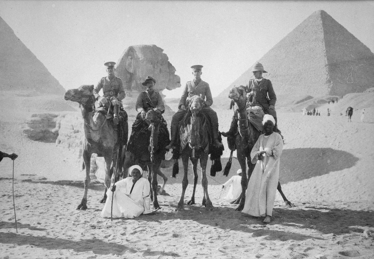 Four men on camels.
