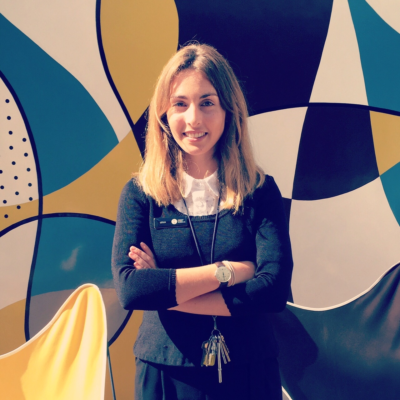 Young woman in front of mural at Rose Seidler House.