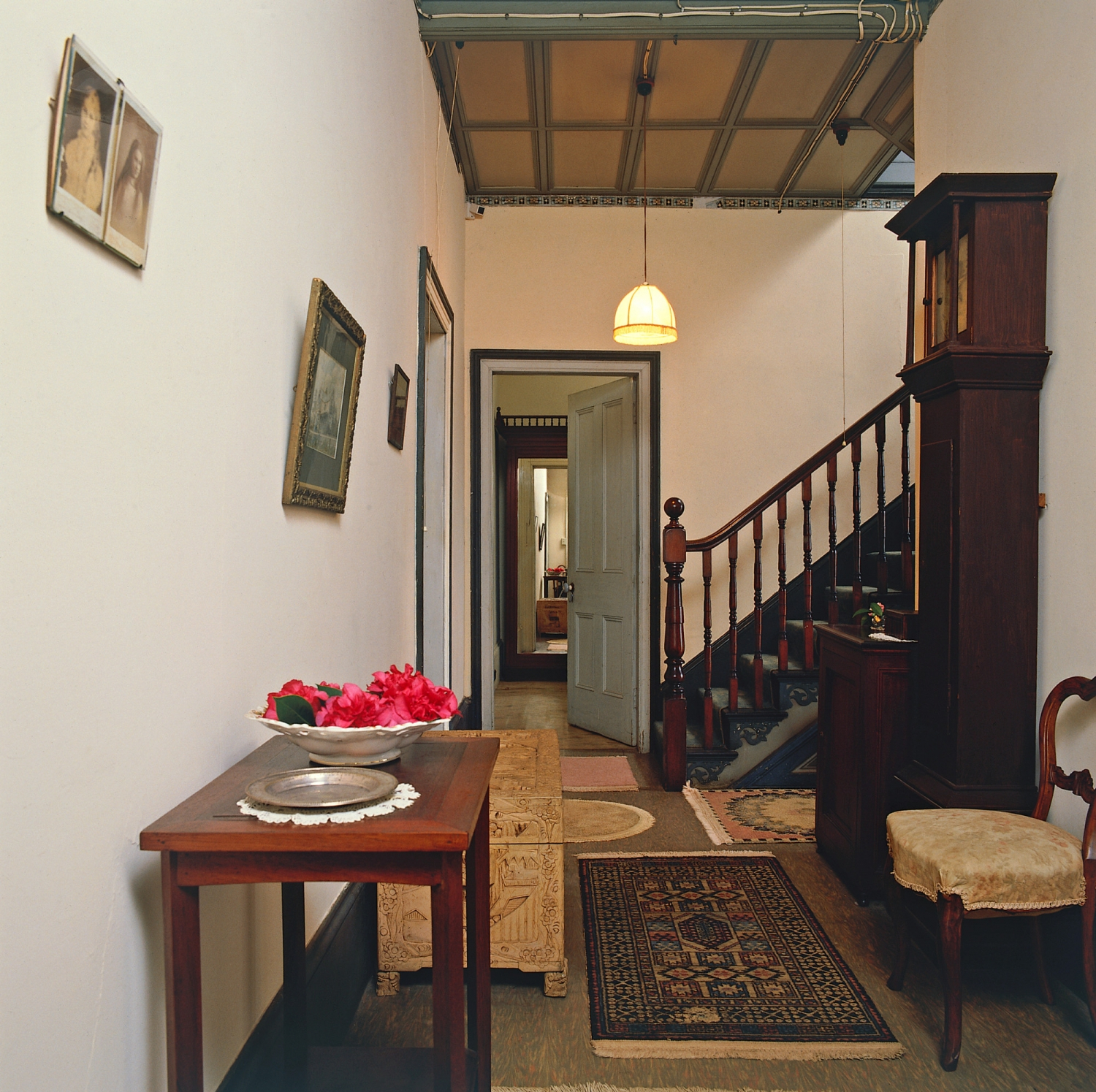 Hallway with furniture and clock.