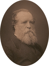 Oval sepia-toned photograph of man with full white beard.