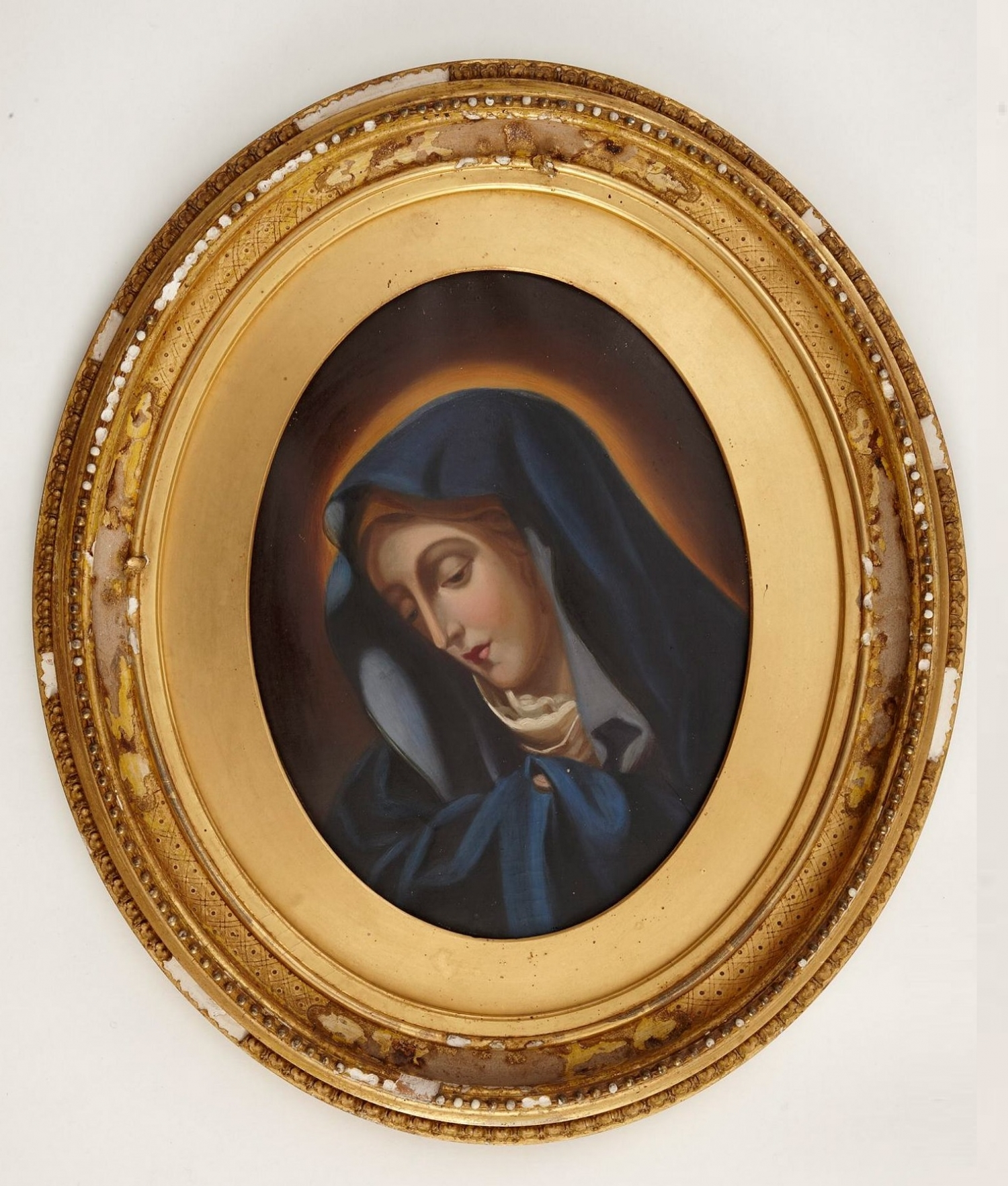 Oval shaped painting in matching oval frame.