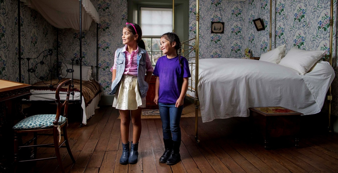 Two girls in bedroom at Vaucluse House