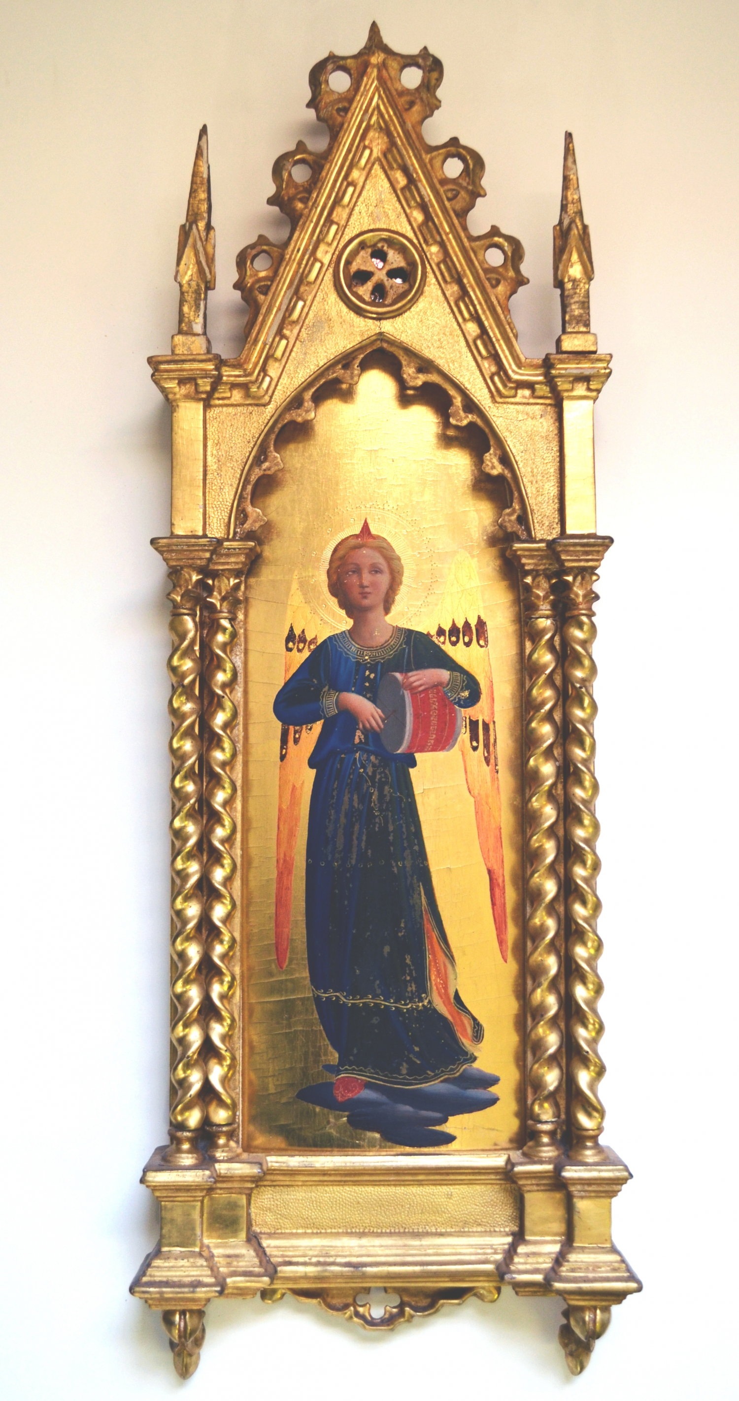 Gilt painted image of saint with halo in gilt painted frame.